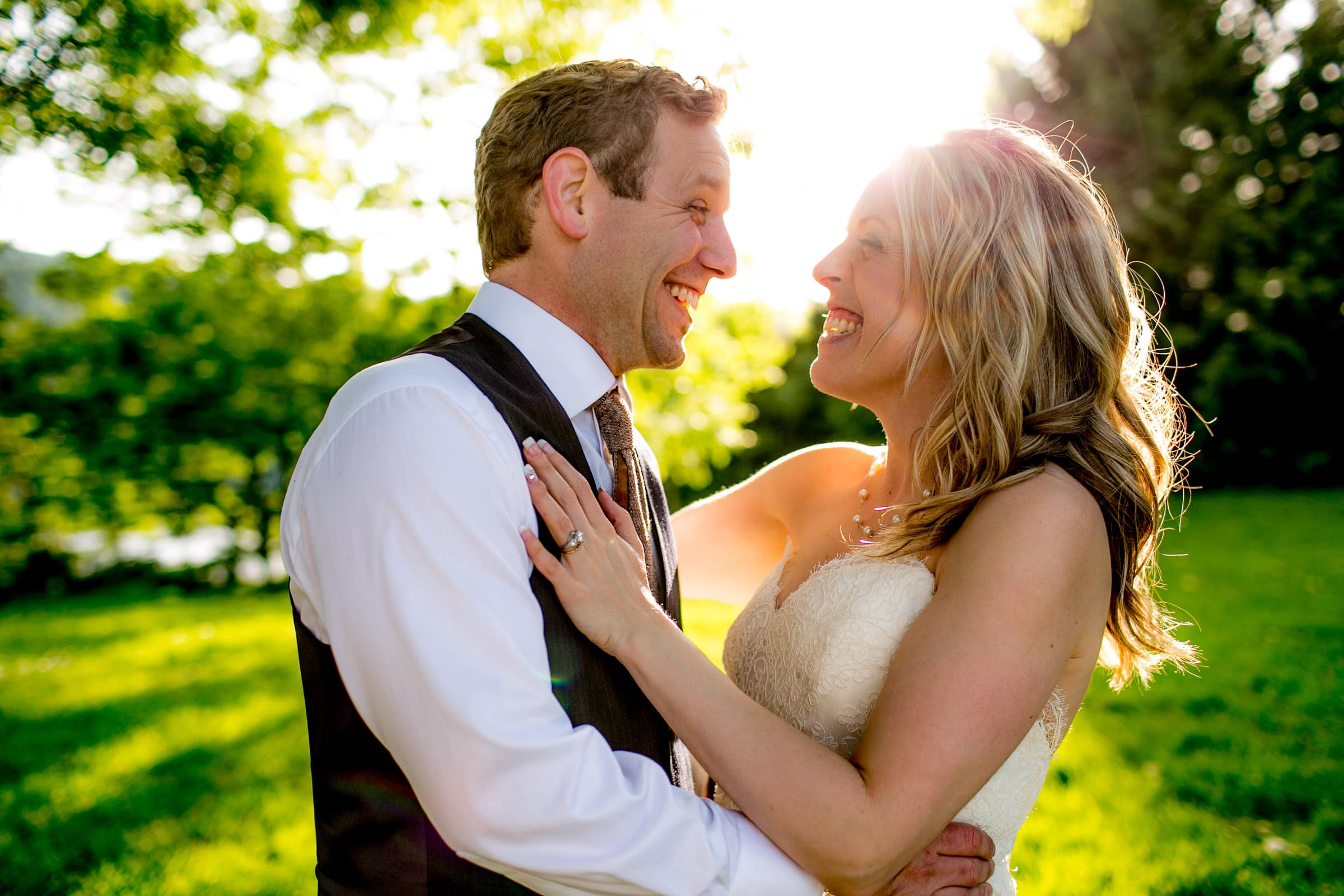 Bride and groom laughing together after their outdoor small Cathedral Park Wedding ceremony in Portland Oregon