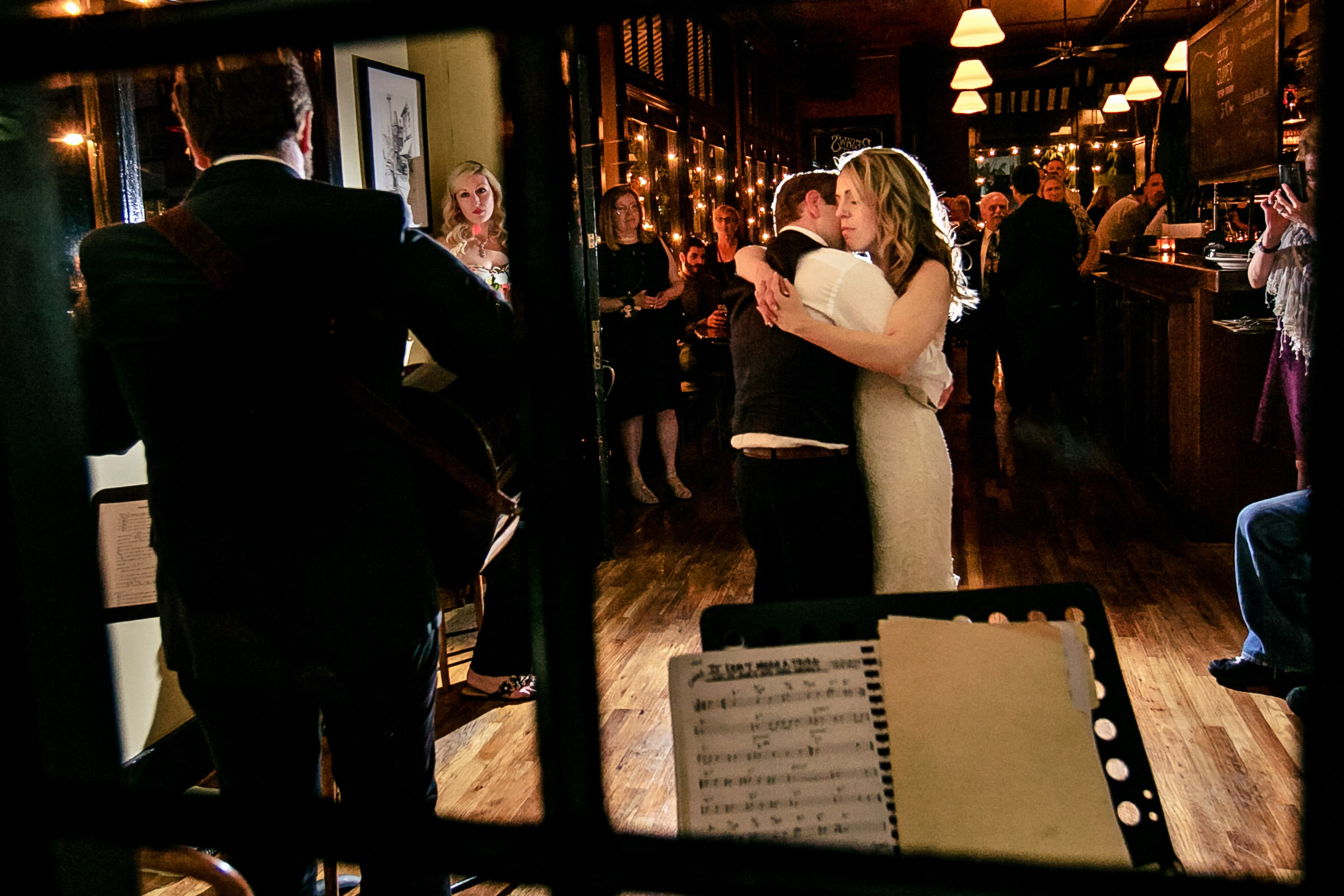 Bride and groom first dance in Besaws restaurant after their outdoor small Cathedral Park Wedding ceremony in Portland Oregon