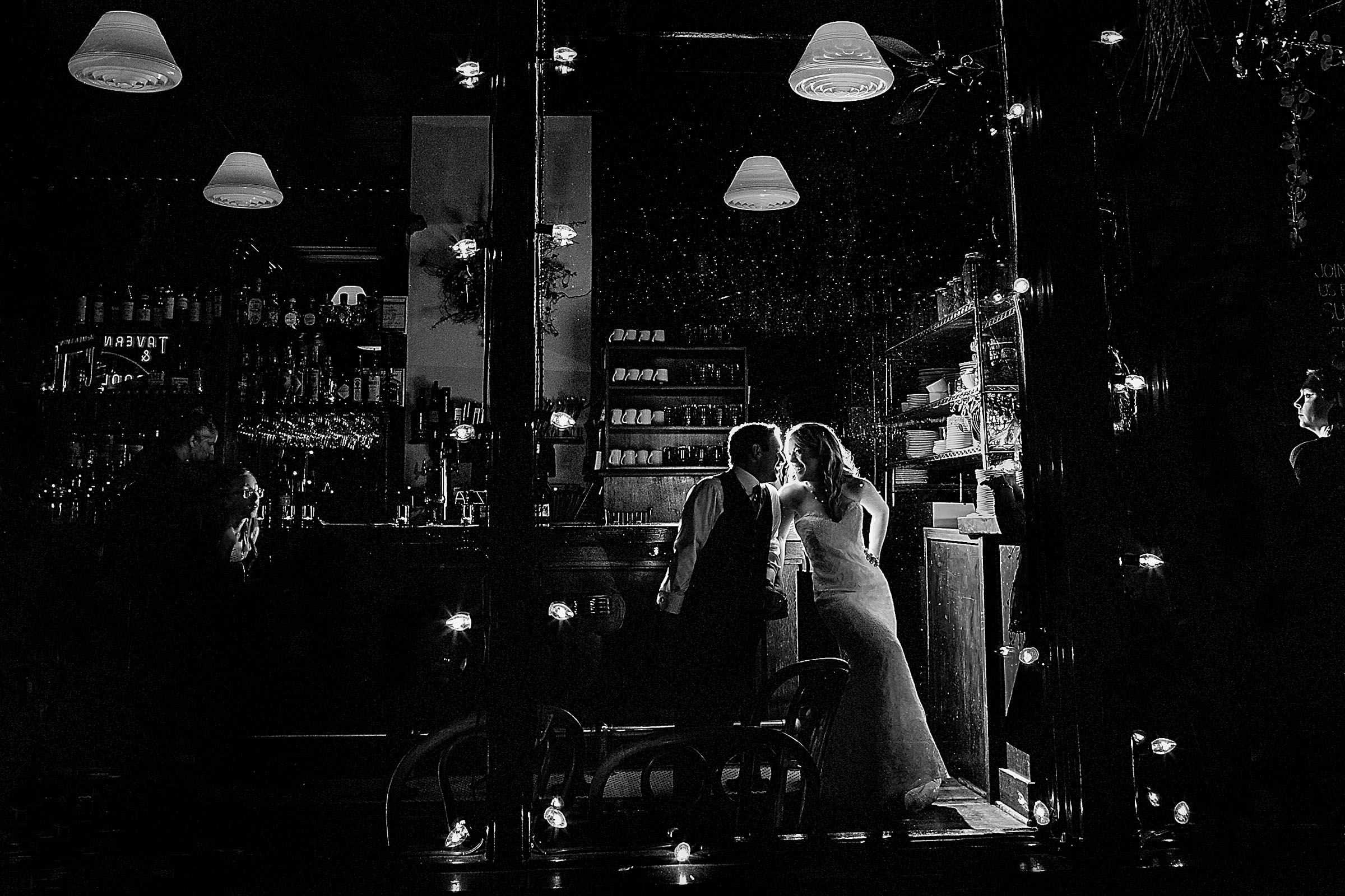 Bride and groom portrait in a bar at Besaws restaurant after their outdoor small Cathedral Park Wedding ceremony in Portland Oregon
