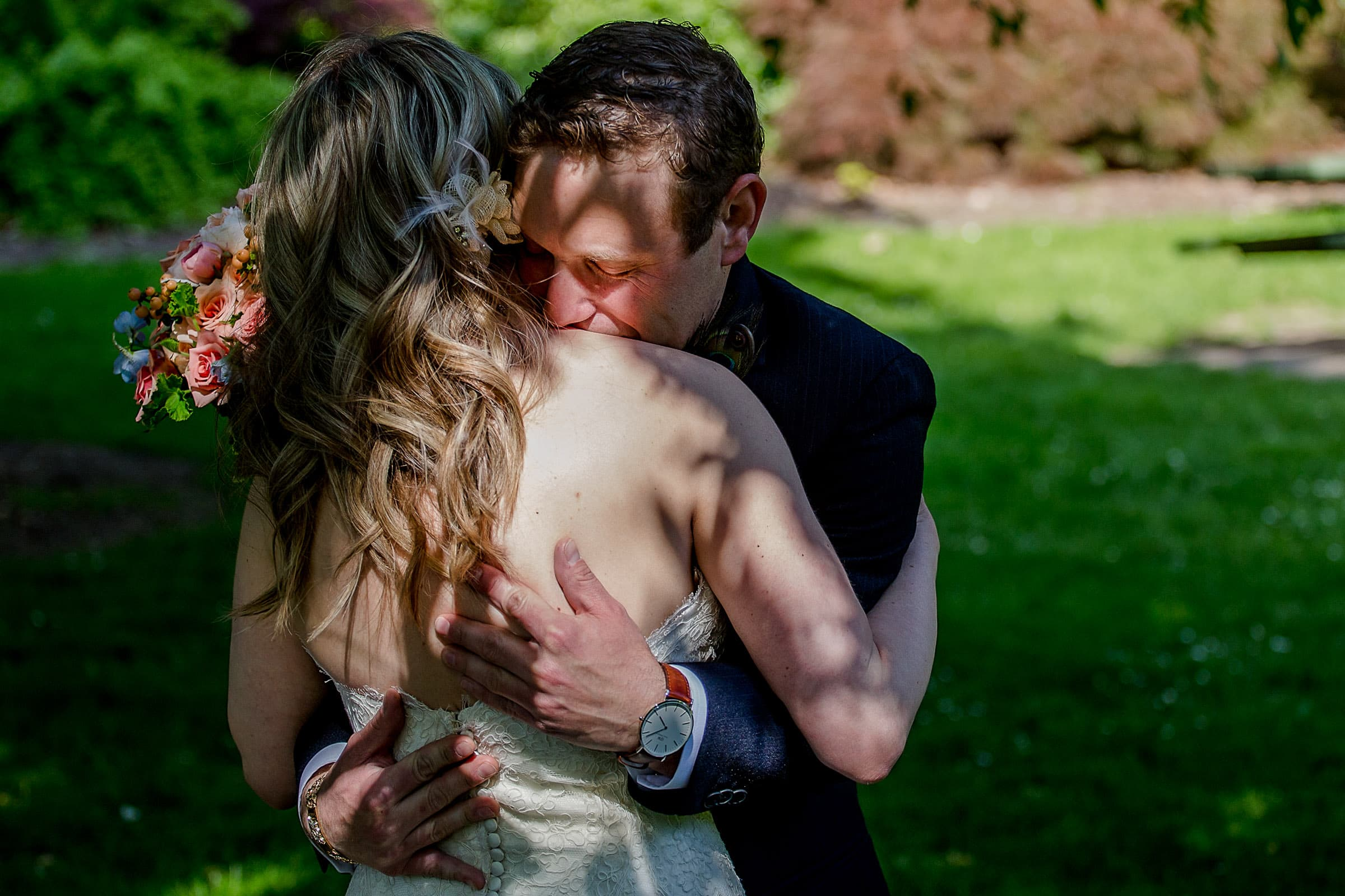 Bride and groom holding each other before their outdoor small Cathedral Park Wedding ceremony in Portland Oregon