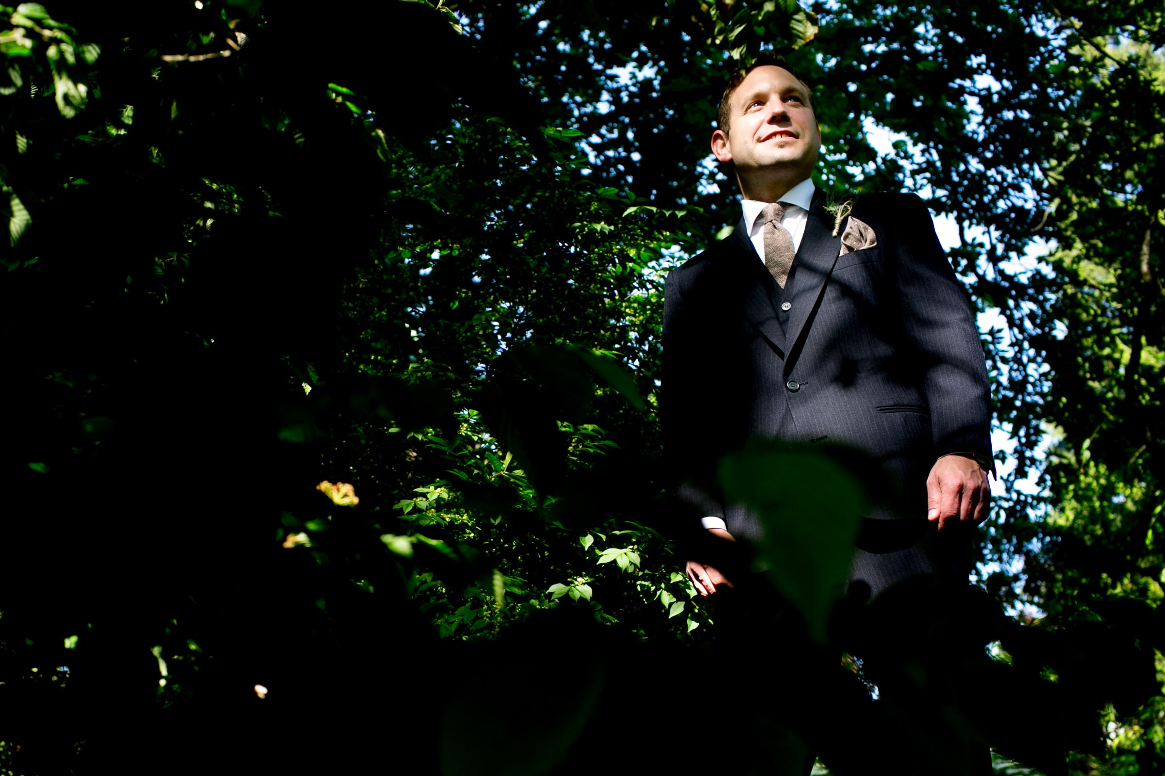 Groom portait before his outdoor small Cathedral Park Wedding ceremony in Portland Oregon
