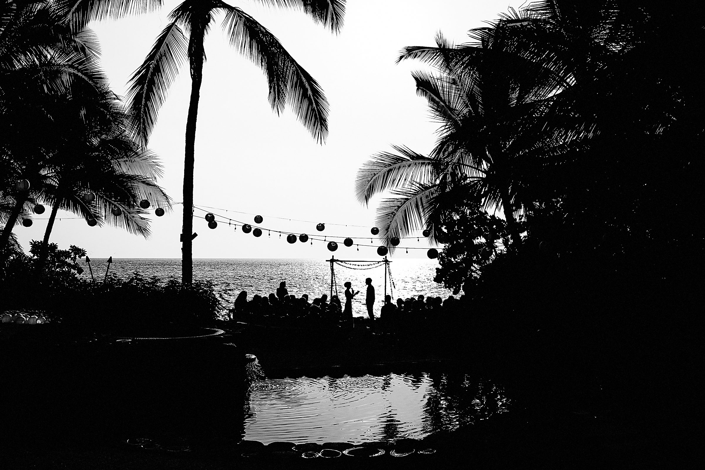 Black and white wide angle perspective of a Kailua Kona Wedding at the Kona Beach Bungalows on the Big Island of Hawaii