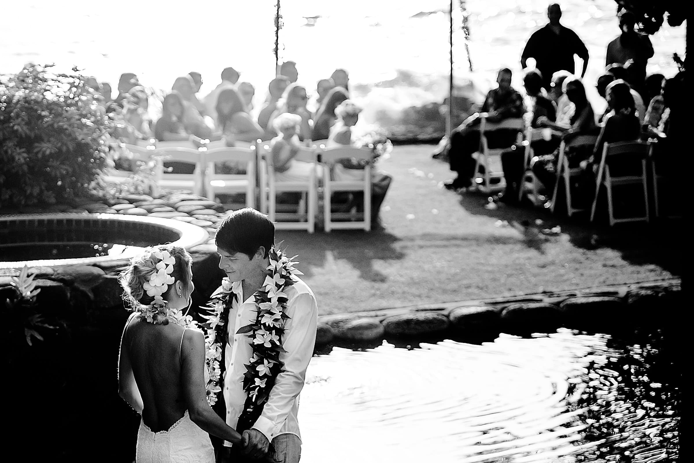 Bride and groom enjoying an emotional moment moments after their Kailua Kona Wedding ceremony at the Kona Beach Bungalows on the Big Island of Hawaii
