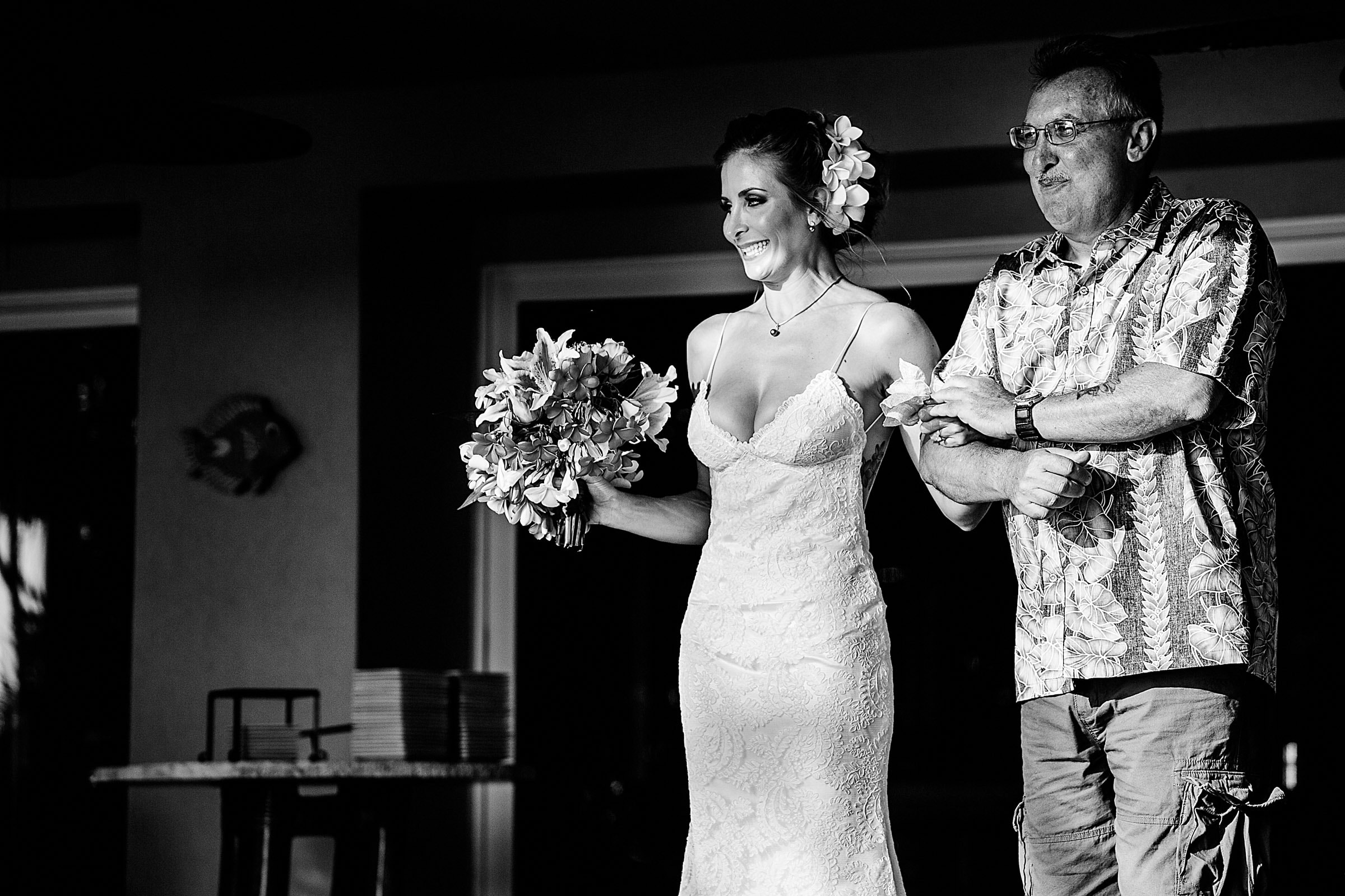 Bride walking with her father heading into her Kailua Kona Wedding at the Kona Beach Bungalows on the Big Island of Hawaii