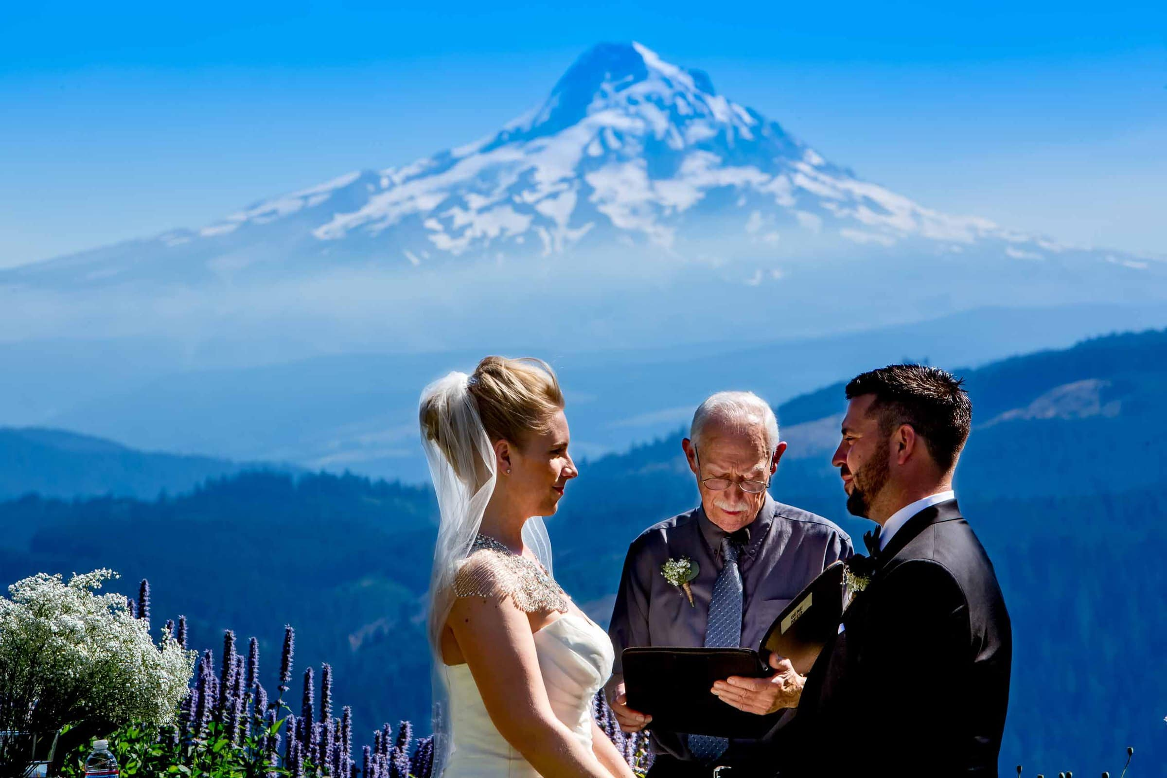Bride and Groom with spectacular view over Columbia River Gorge during ceremony at Gorge Crest