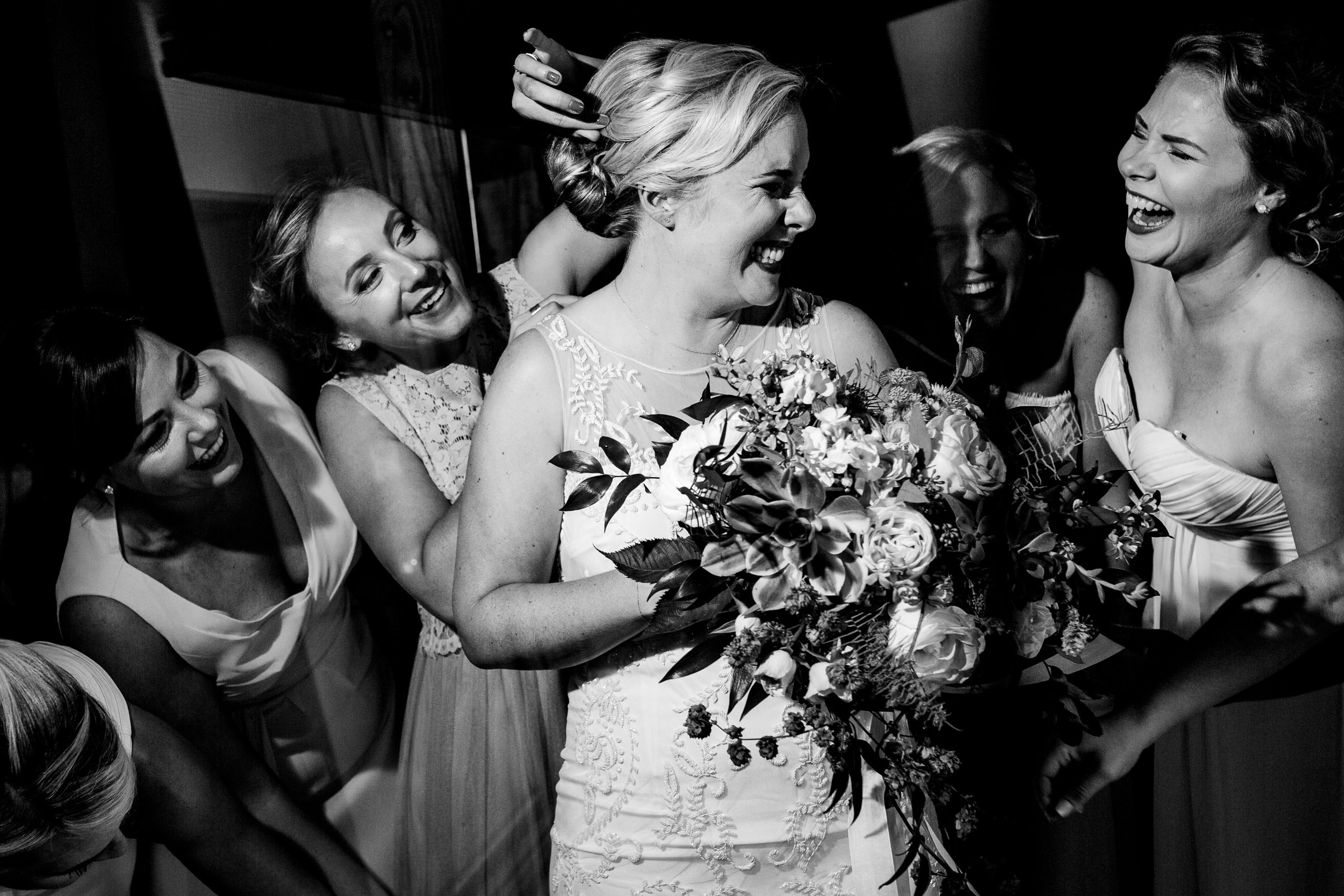 Bride and friends laughing while getting ready for a Black Butte Ranch Wedding