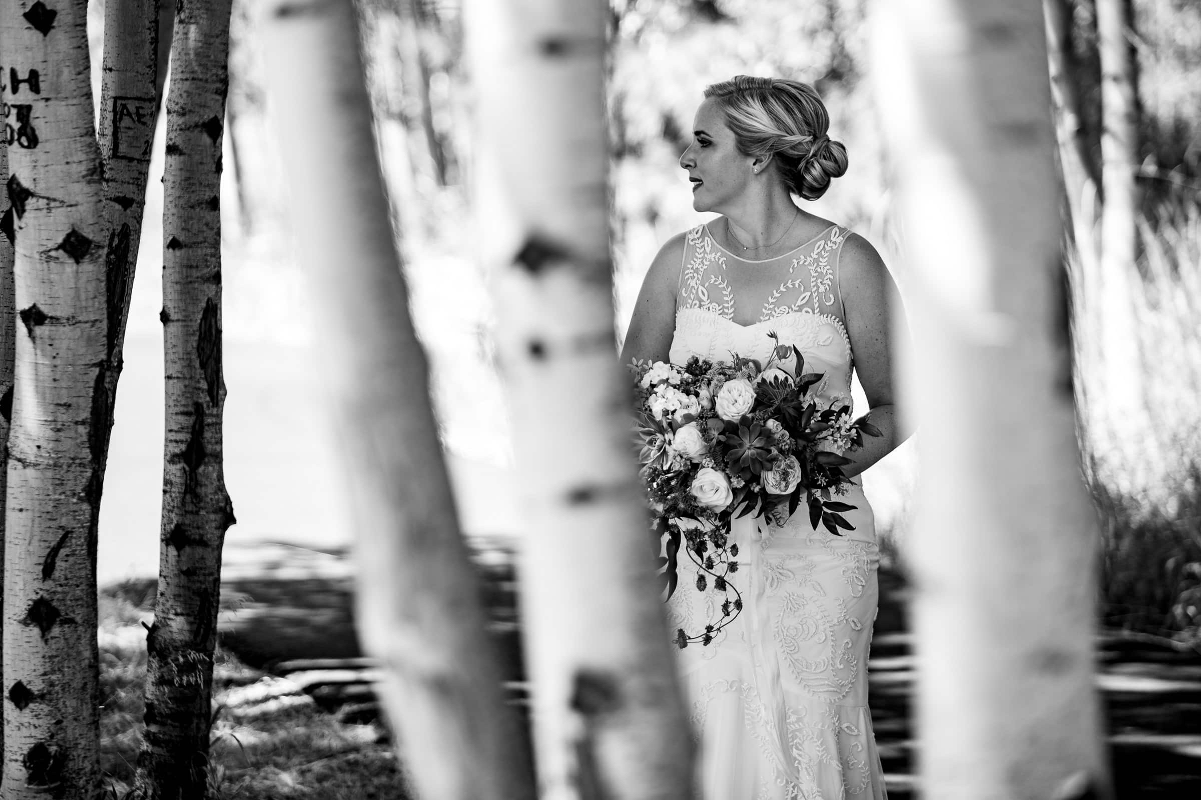 Beautiful bride in birch trees at her Black Butte Ranch wedding in Central Oregon