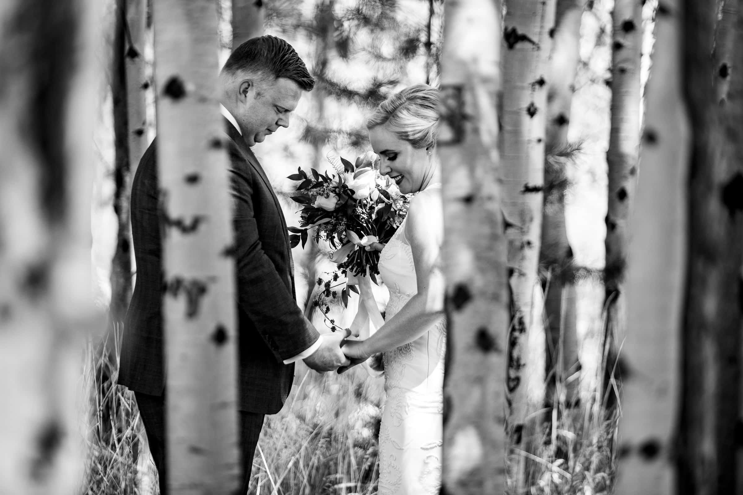 Bride and groom seeing each other in an Aspen Grove for their Black Butte Ranch wedding in Central Oregon
