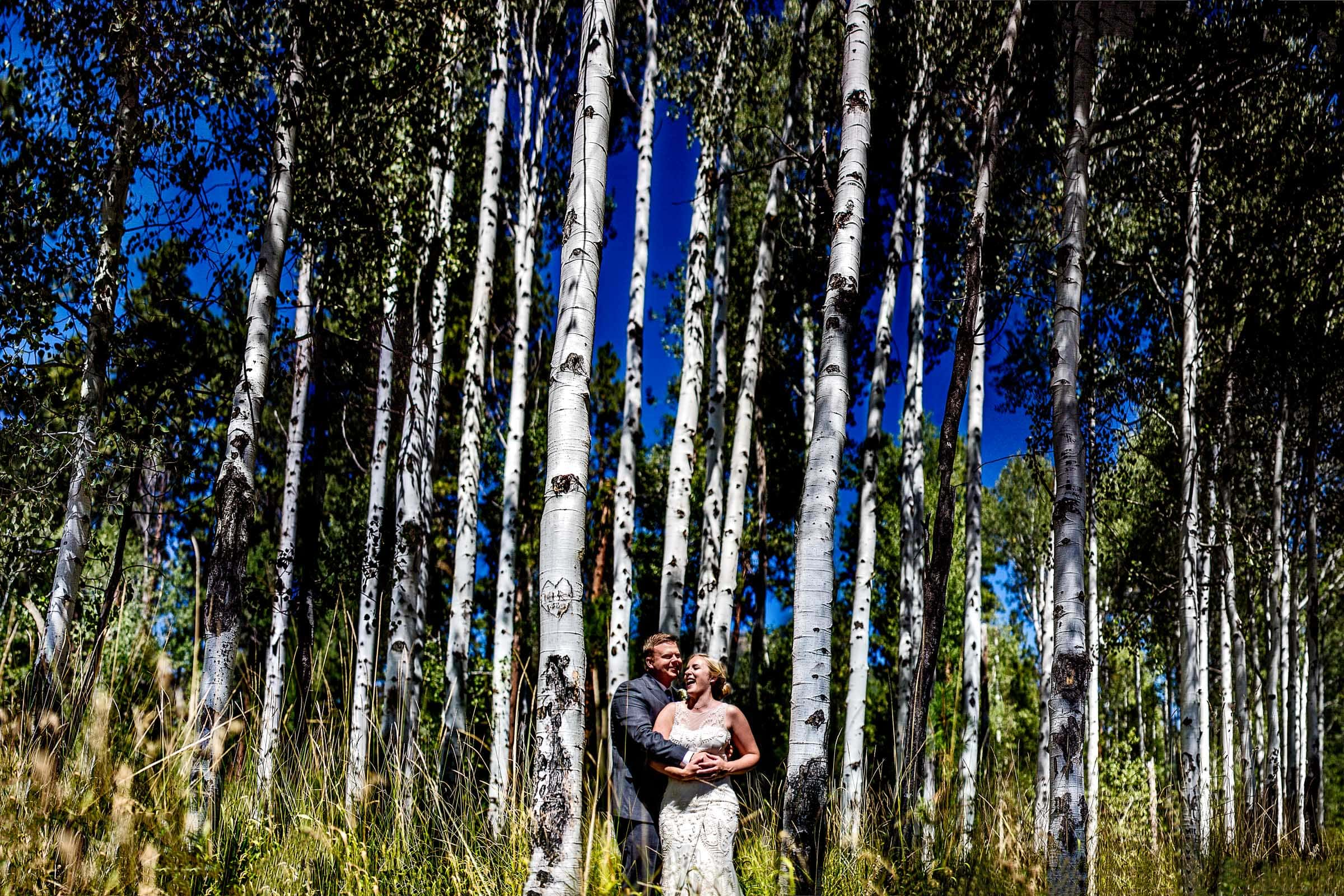 Bride and groom creative portrait in birch trees at their Black Butte Ranch wedding in Central Oregon