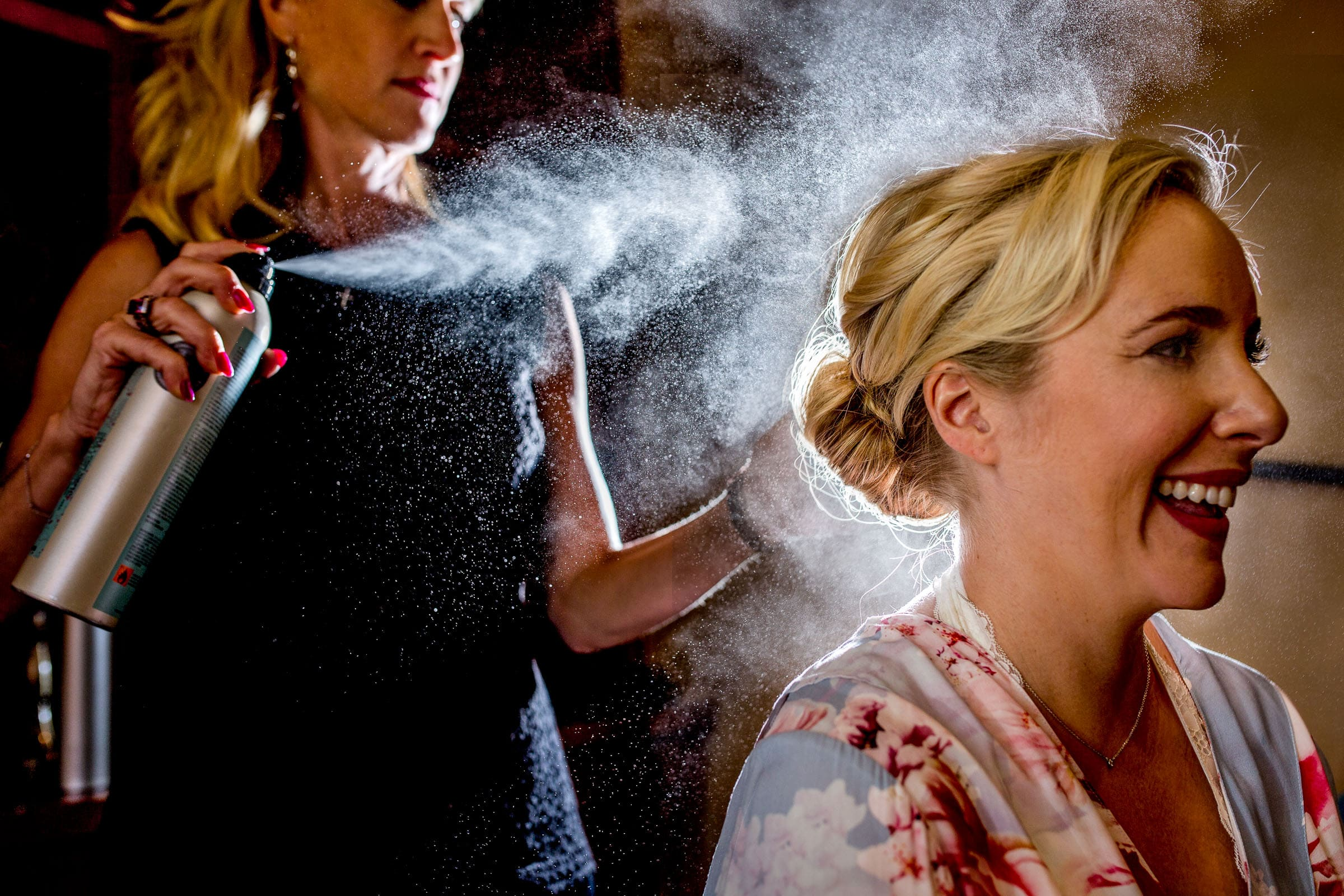 Dynamic photo of a bride getting her hair done for her Black Butte Ranch Wedding