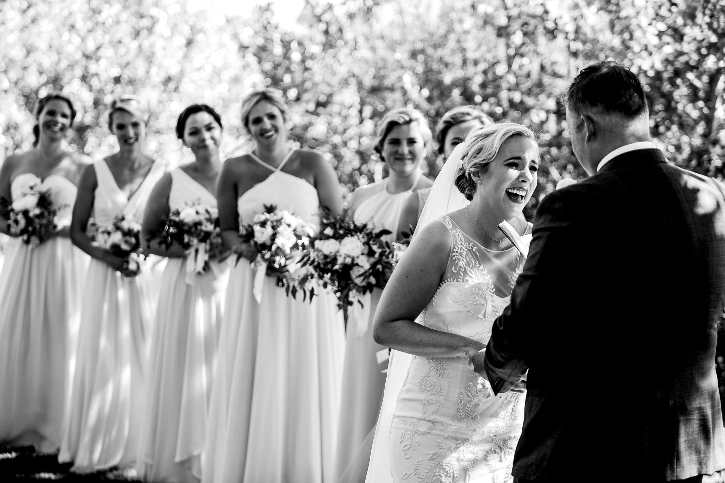 Happy bride laughing during her Black Butte Ranch wedding ceremony in Central Oregon