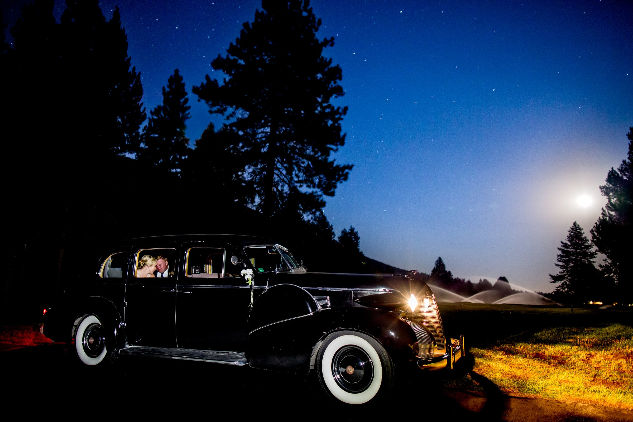 Bride and groom exiting in their get away car at their Black Butte Ranch wedding ceremony in Central Oregon