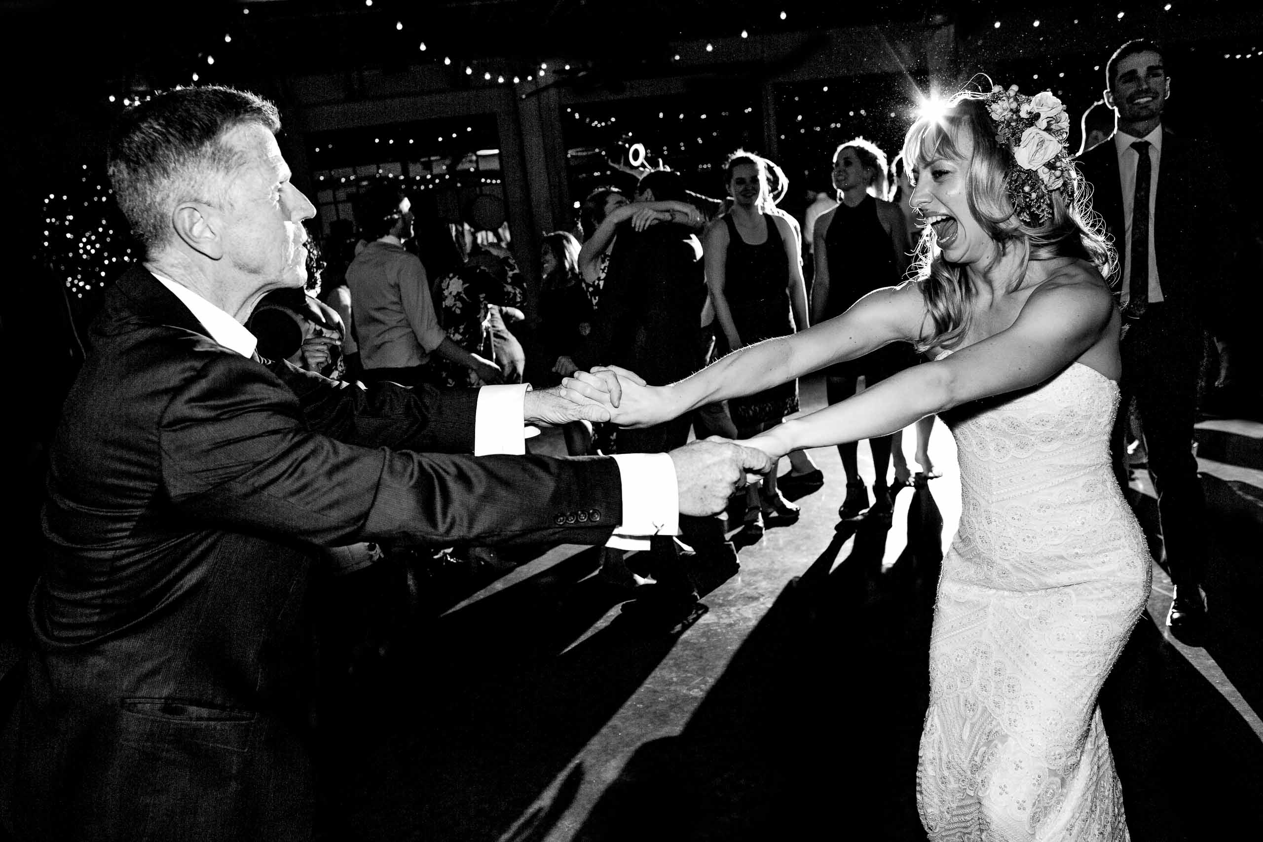 Bride dancing with her father during a Castaway Portland wedding