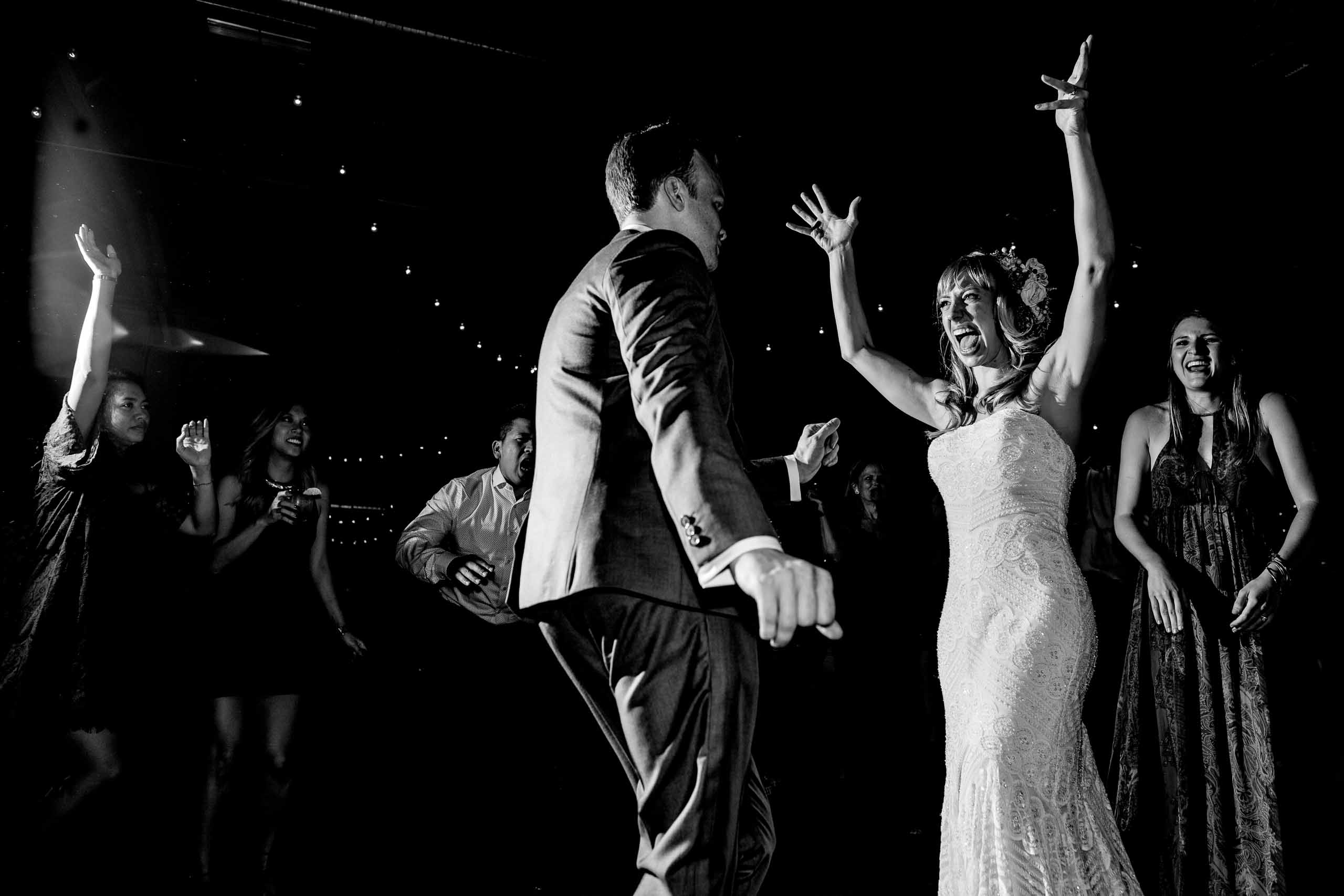 Bride and groom dancing wild at their Castaway Portland wedding