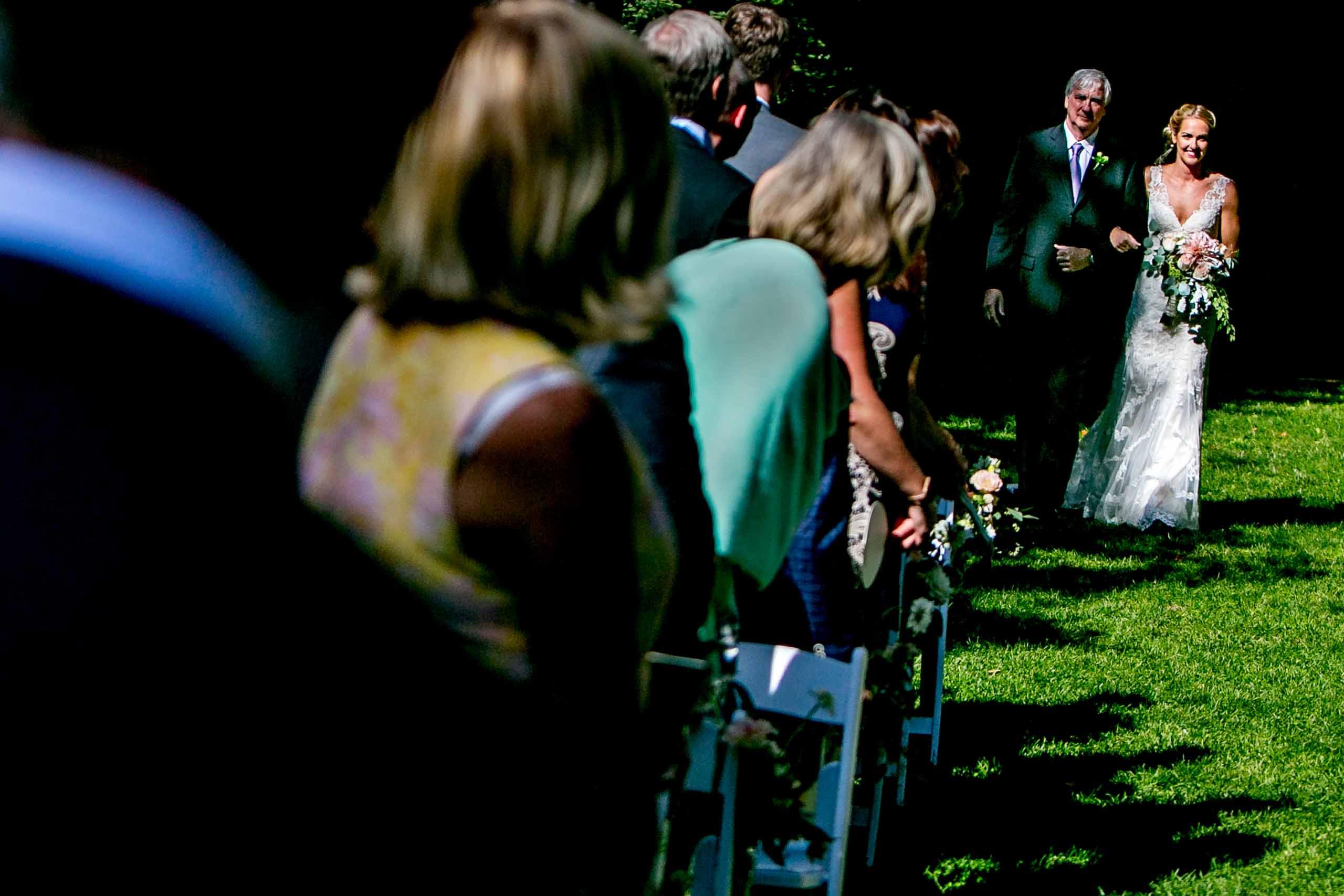 Bride walking with father into a Mt Hood Organic Farms wedding near Hood River Oregon