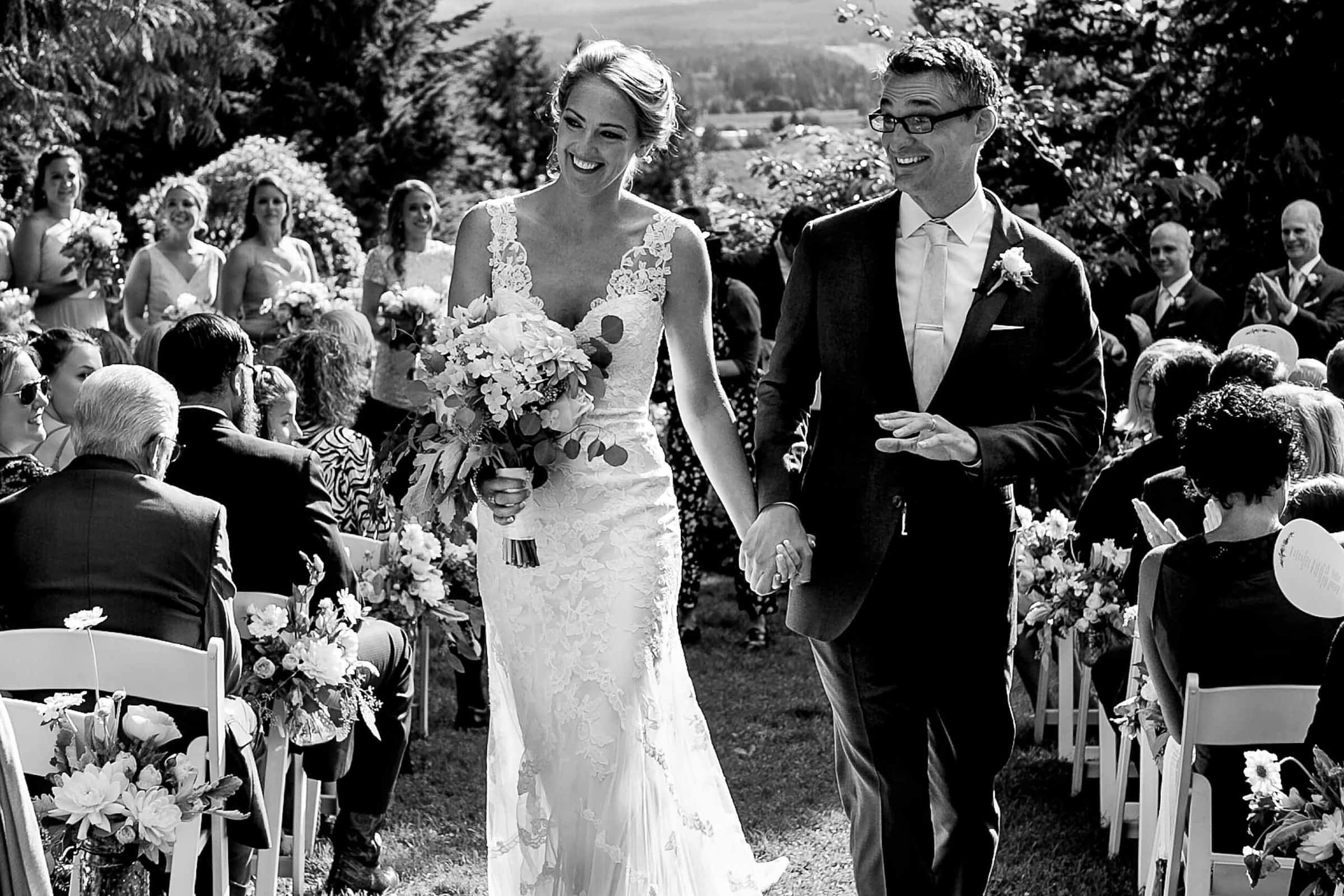 Bride and groom exiting their Mt Hood Organic Farms wedding ceremony near Hood River Oregon