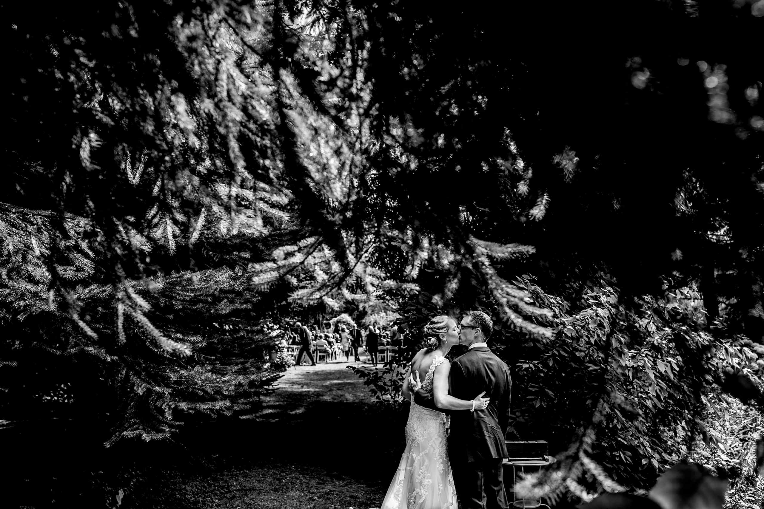 Bride and groom embracing moments after their Mt Hood Organic Farms wedding ceremony near Hood River Oregon