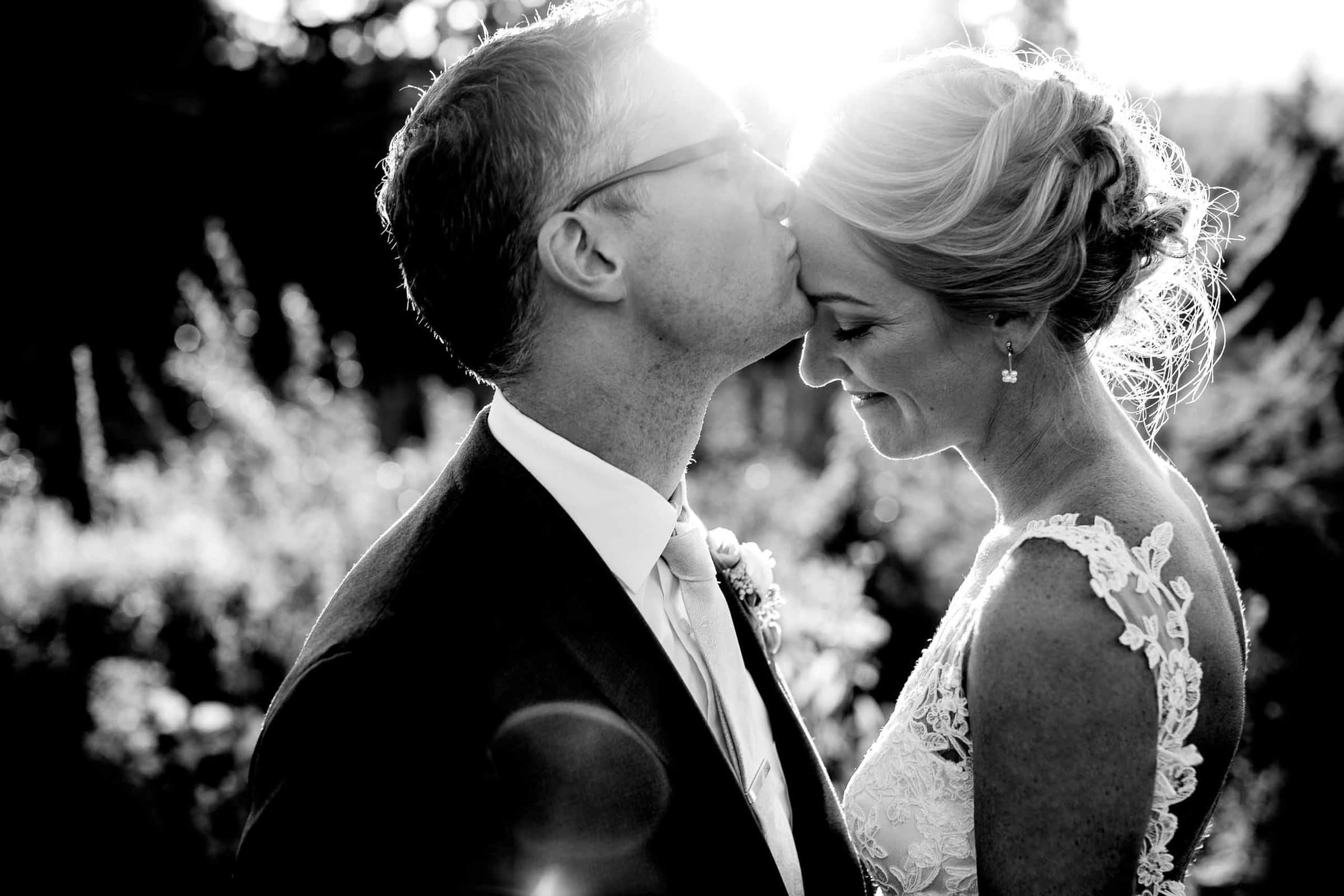 Bride and groom embracing at sunset during their Mt Hood Organic Farms wedding near Hood River Oregon