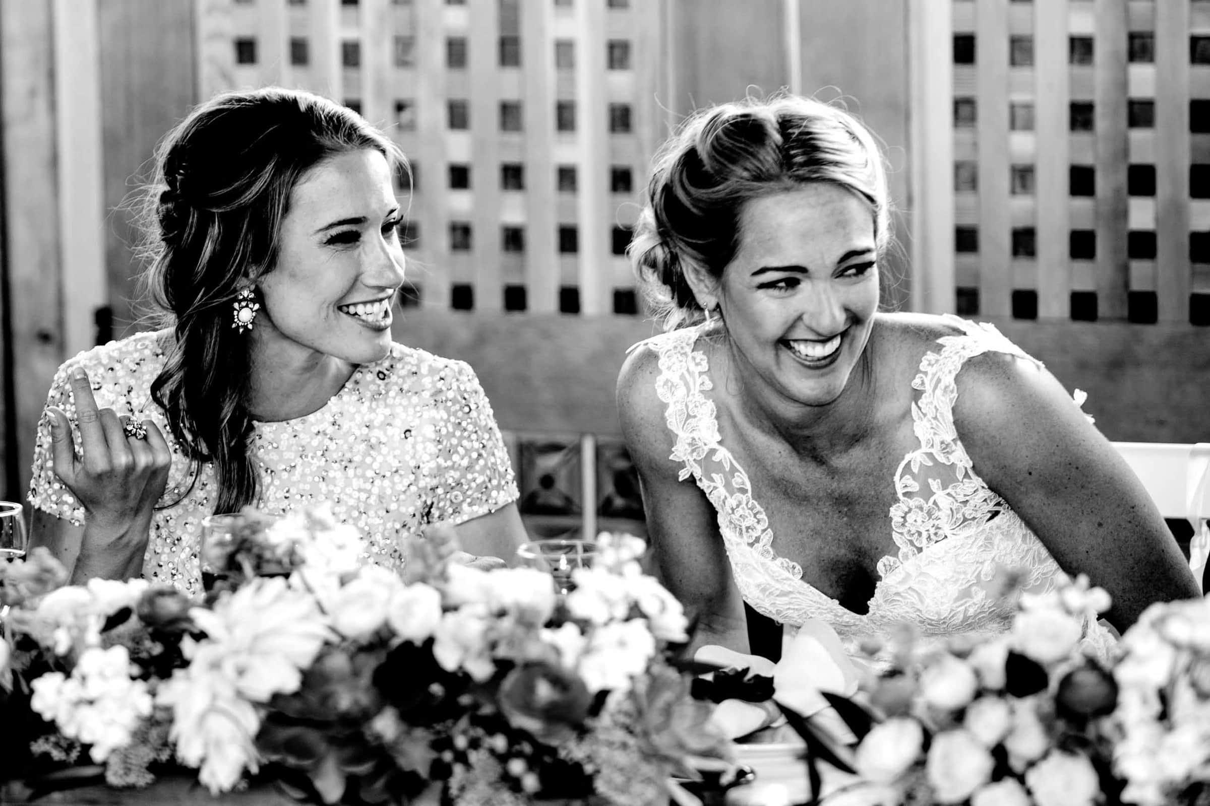 Fun photo of bride and best friend at a Mt Hood Organic Farms wedding reception near Hood River Oregon
