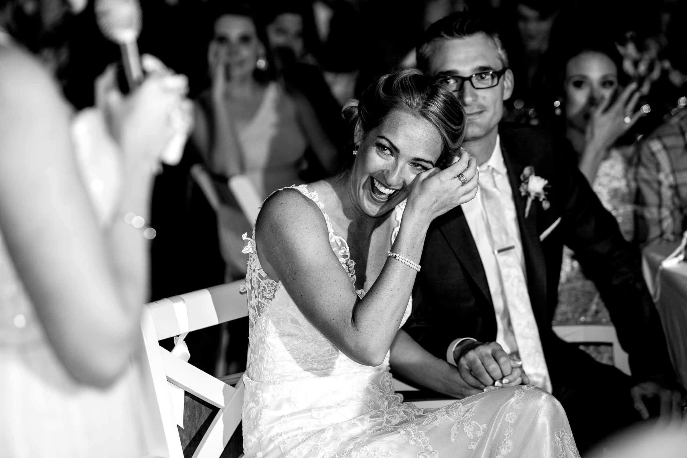 Emotional bride and groom listening to an epic speech during their Mt Hood Organic Farms wedding reception near Hood River Oregon