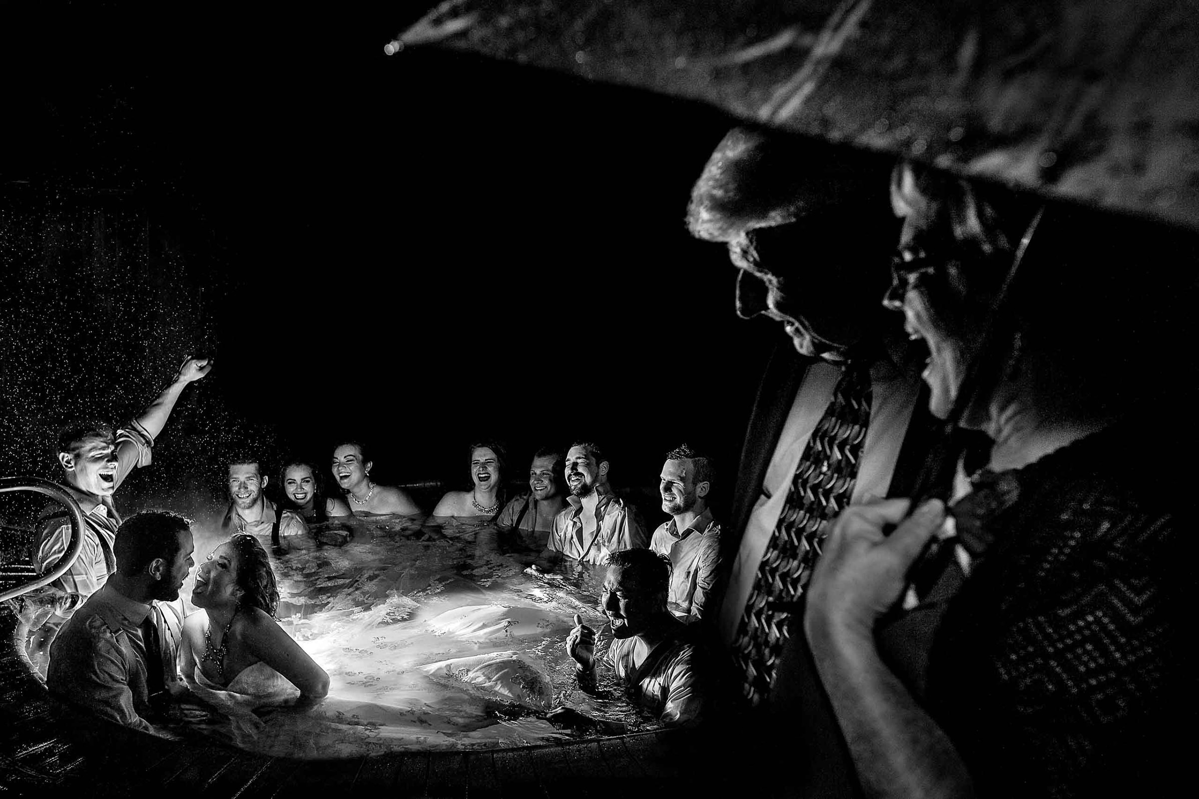 bride and groom in hot tub late night party at Resort at the Mountain on Mt Hood