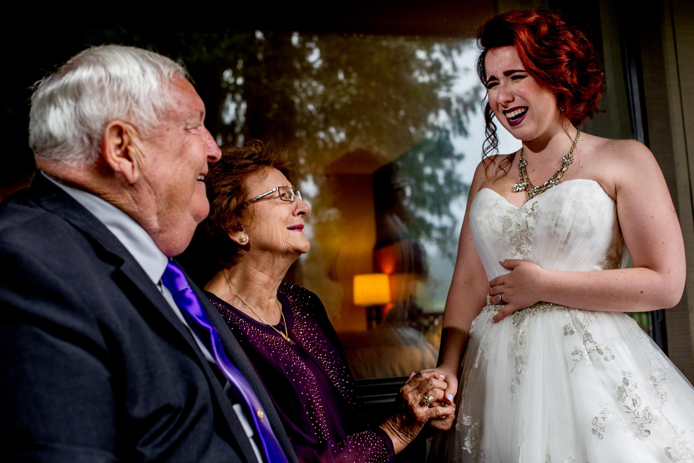 Emotional bride expressing her love to her grandparents at her Resort at the Mountain wedding in Oregon on Mt Hood