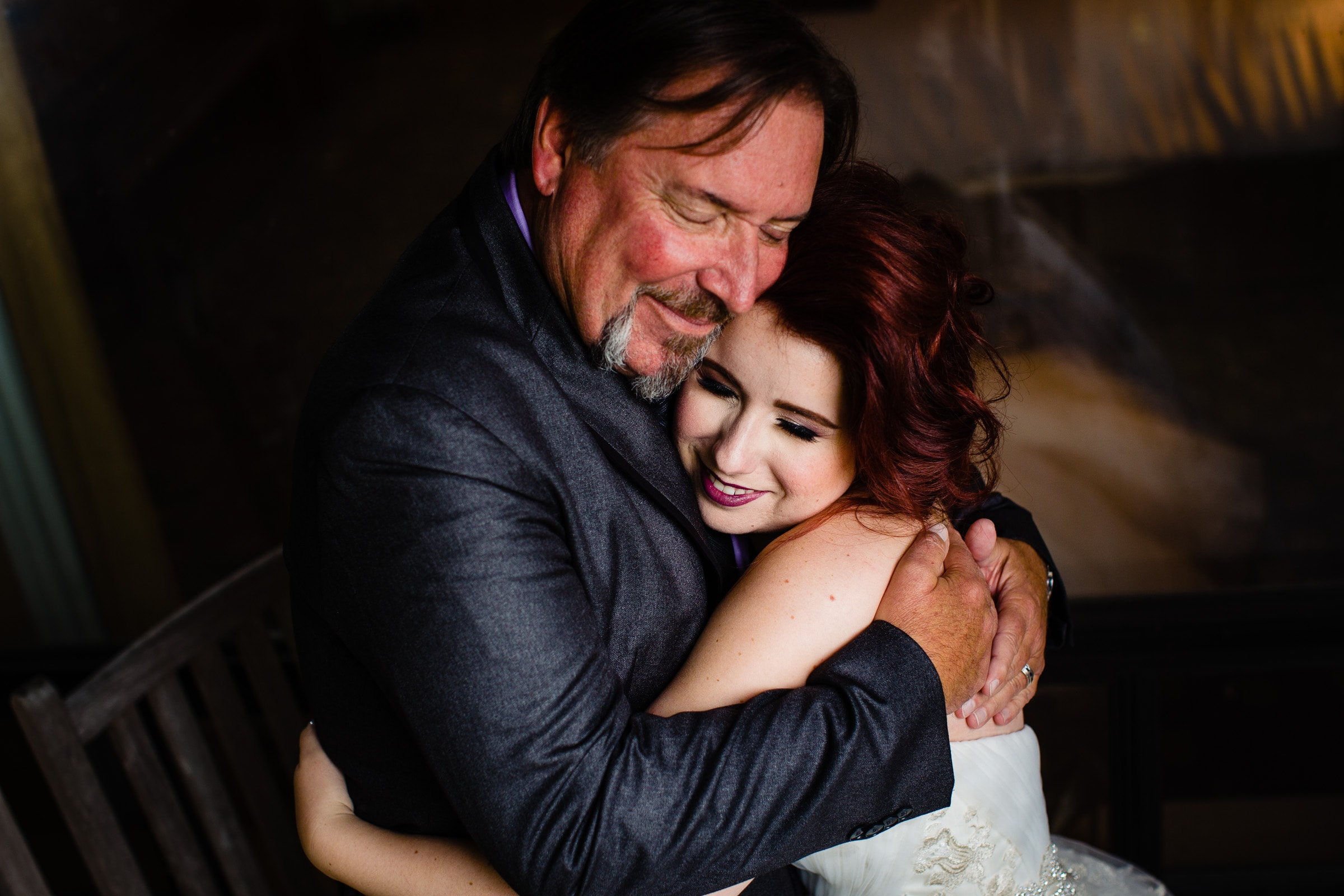 Bride hugging her father with love at her Resort at the Mountain wedding in Oregon on Mt Hood