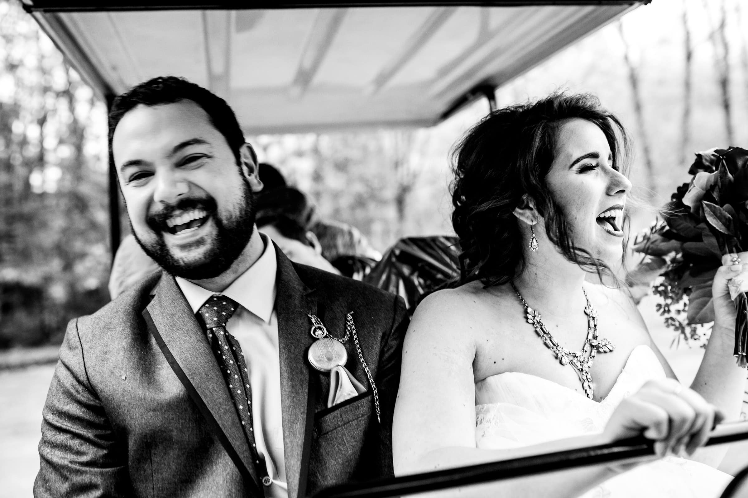 Happy bride and groom riding a golf cart at their Resort at the Mountain wedding on Mt Hood in Oregon