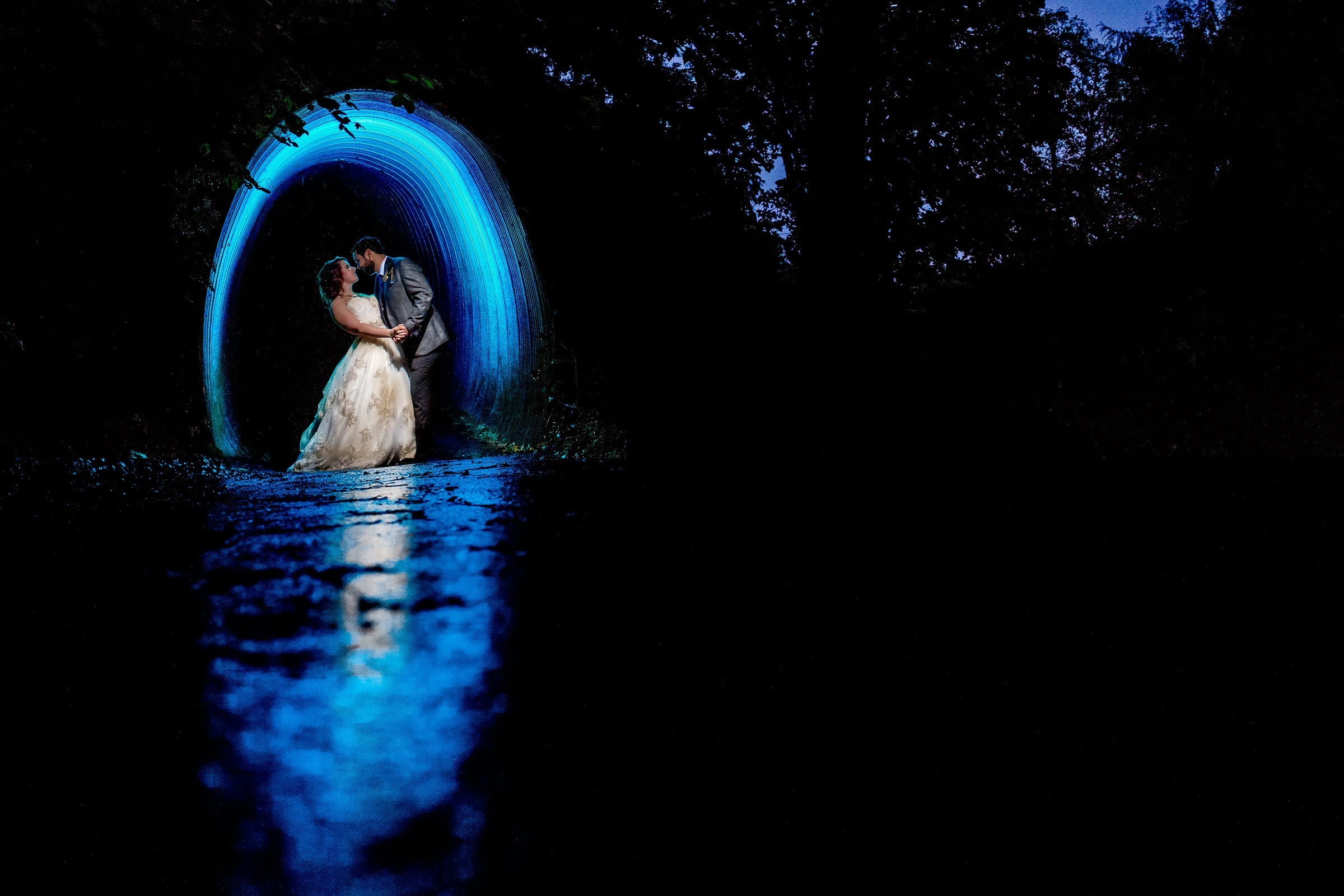 Creative portrait of bride and groom in a blue tunnel during their Resort at the Mountain wedding in Oregon on Mt Hood