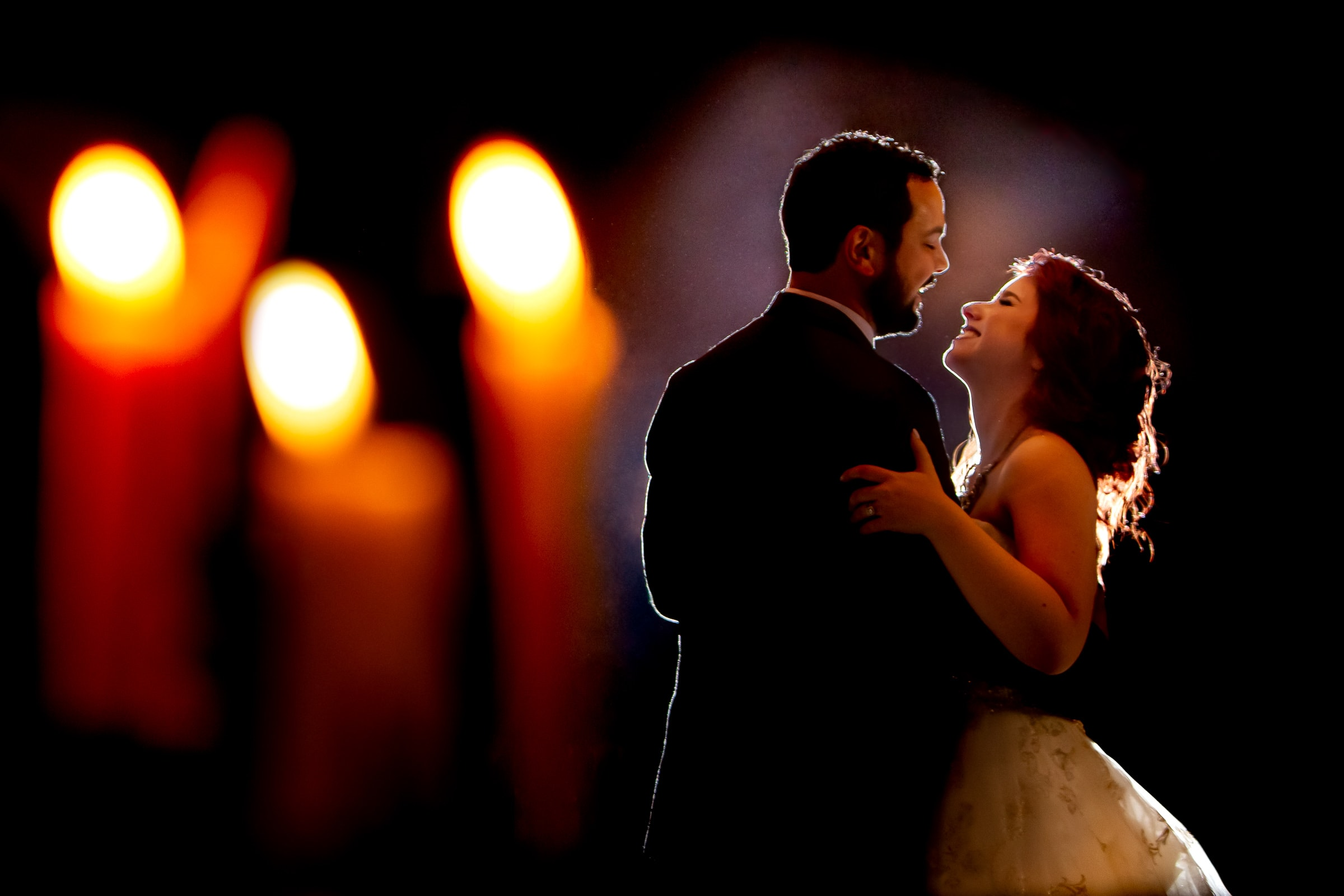 Amazing bride and groom photo captured through candle light for their first dance during their Resort at the Mountain wedding near Mt Hood in Oregon
