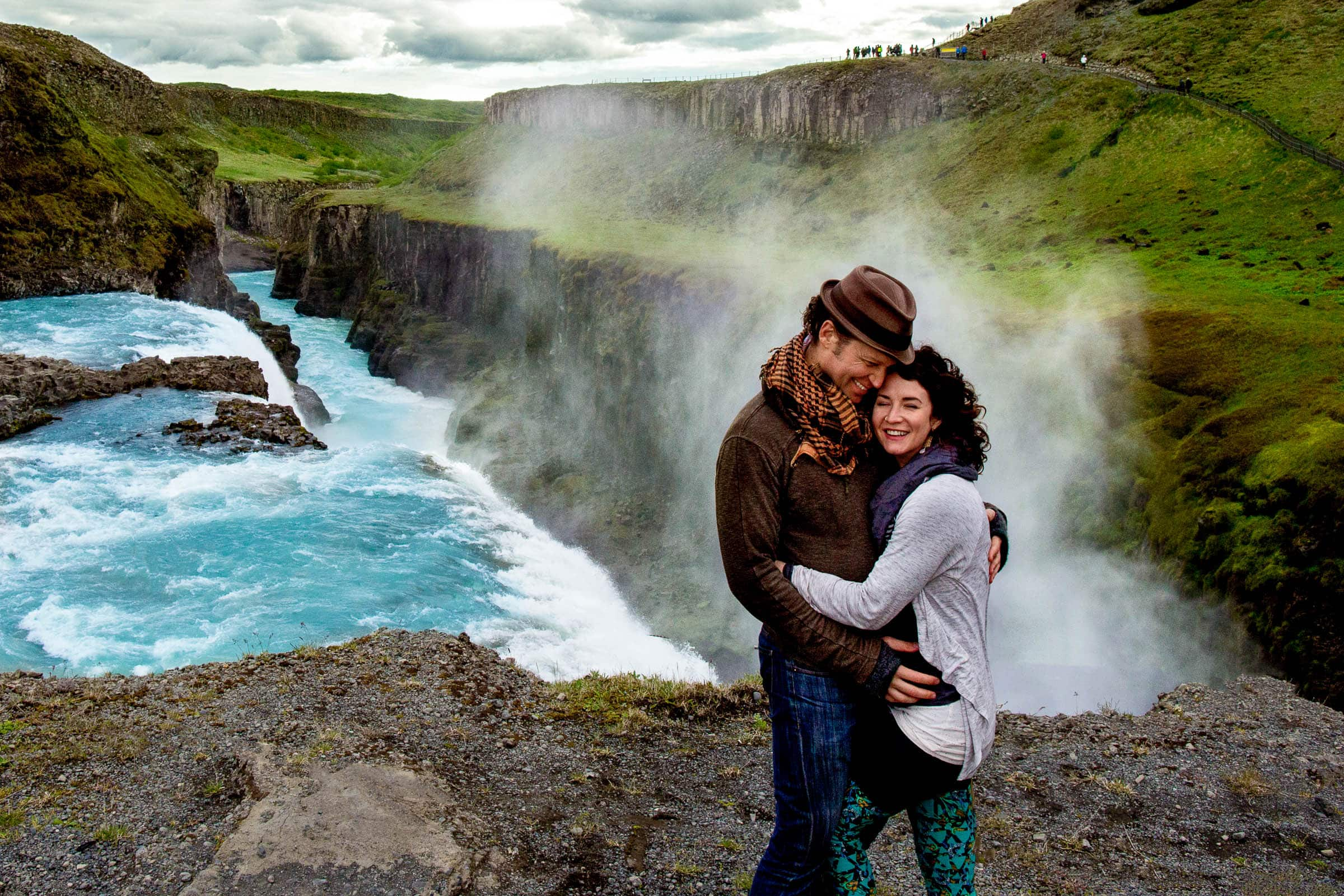 A lovely Portrait of a couple near Gullfoss waterfall illustrating Jos and Tree's Iceland engagement photo ideas