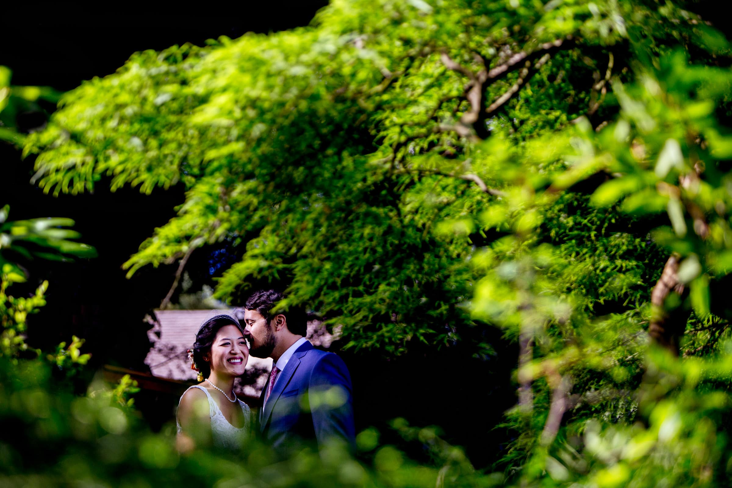 Bride and groom walking together in their backyard garden before their Seattle elopement