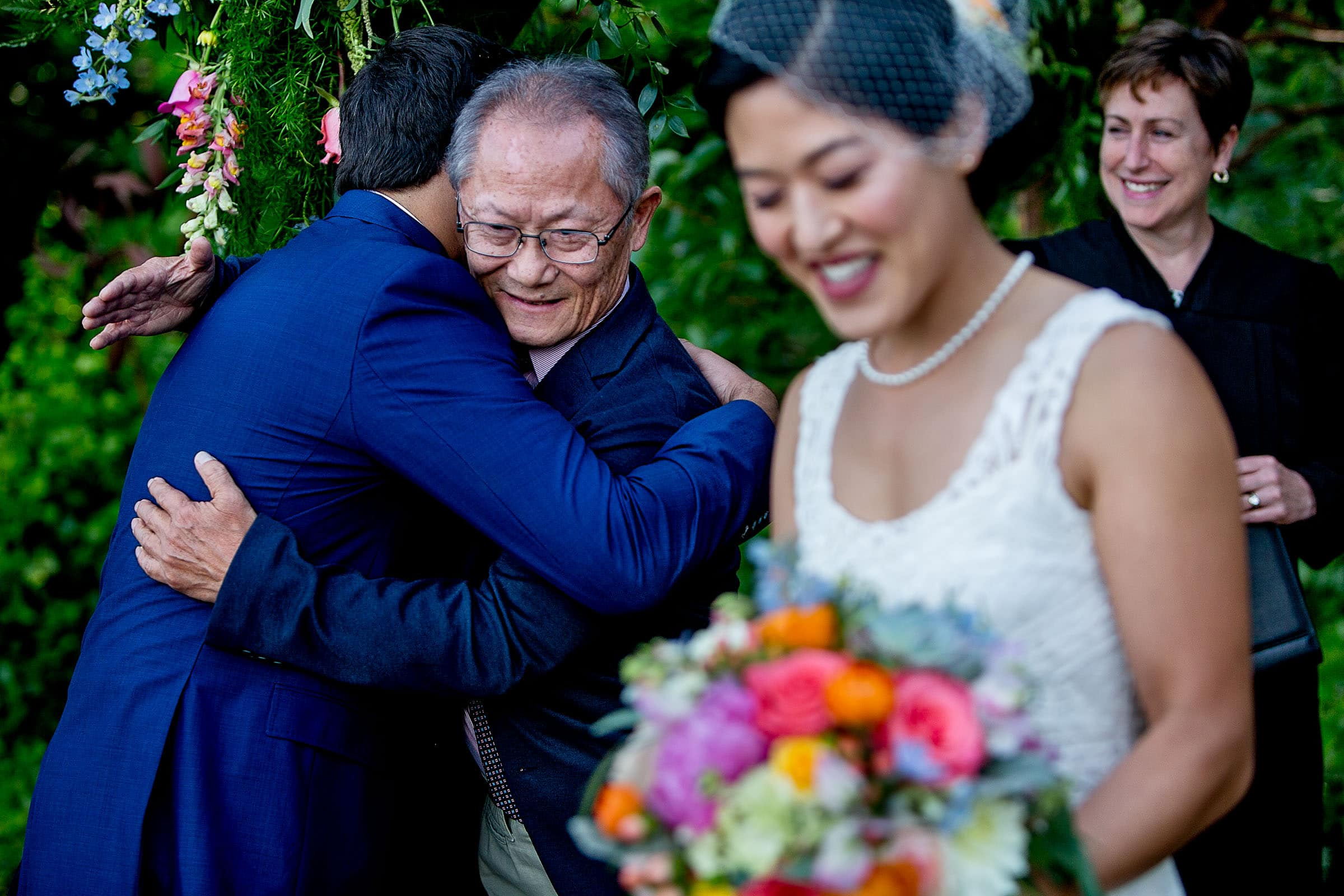 Father hugging groom during a private Seattle elopement ceremony
