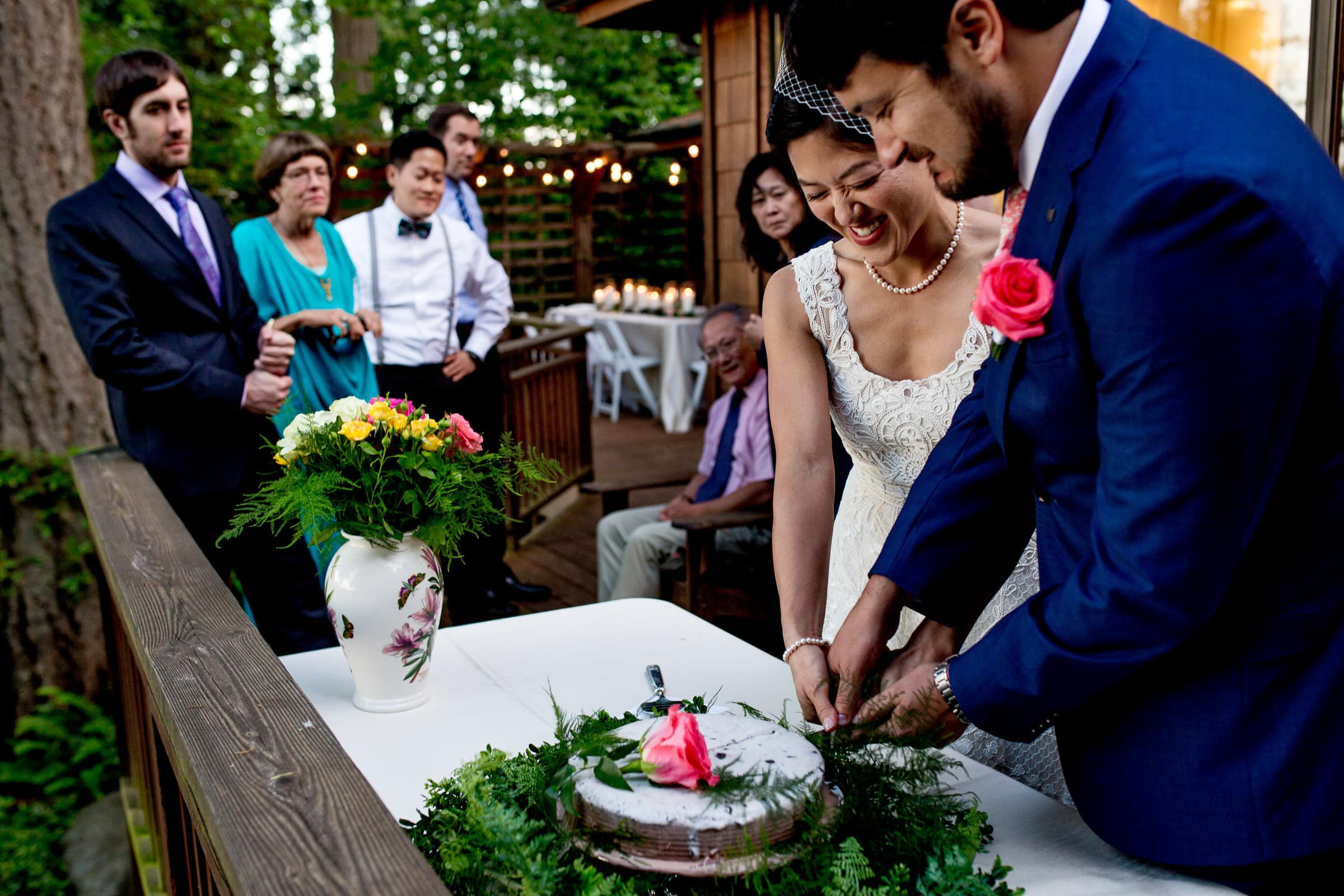 Bride and groom cutting cake during a small Seattle elopement