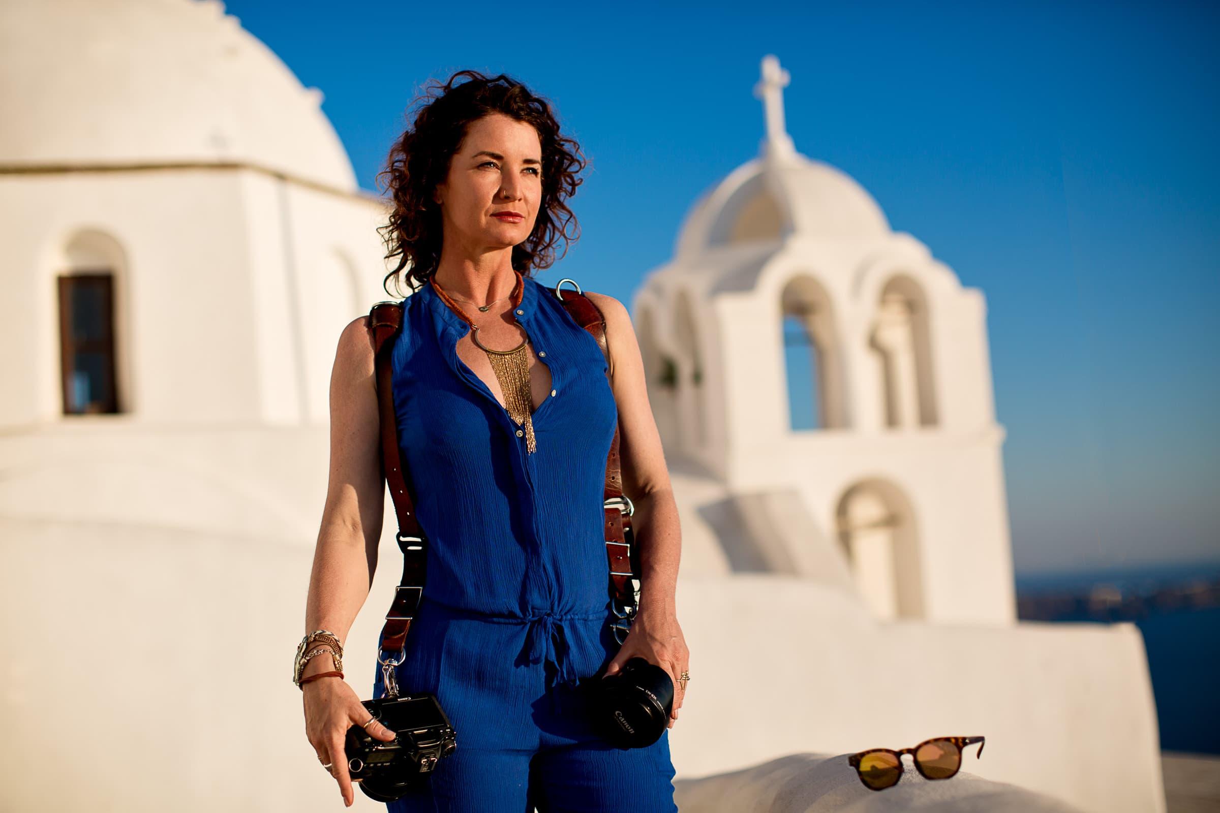 Award winning wedding photographer Tree Marie WoodSmith portrait while exploring Santorini Engagement photo ideas