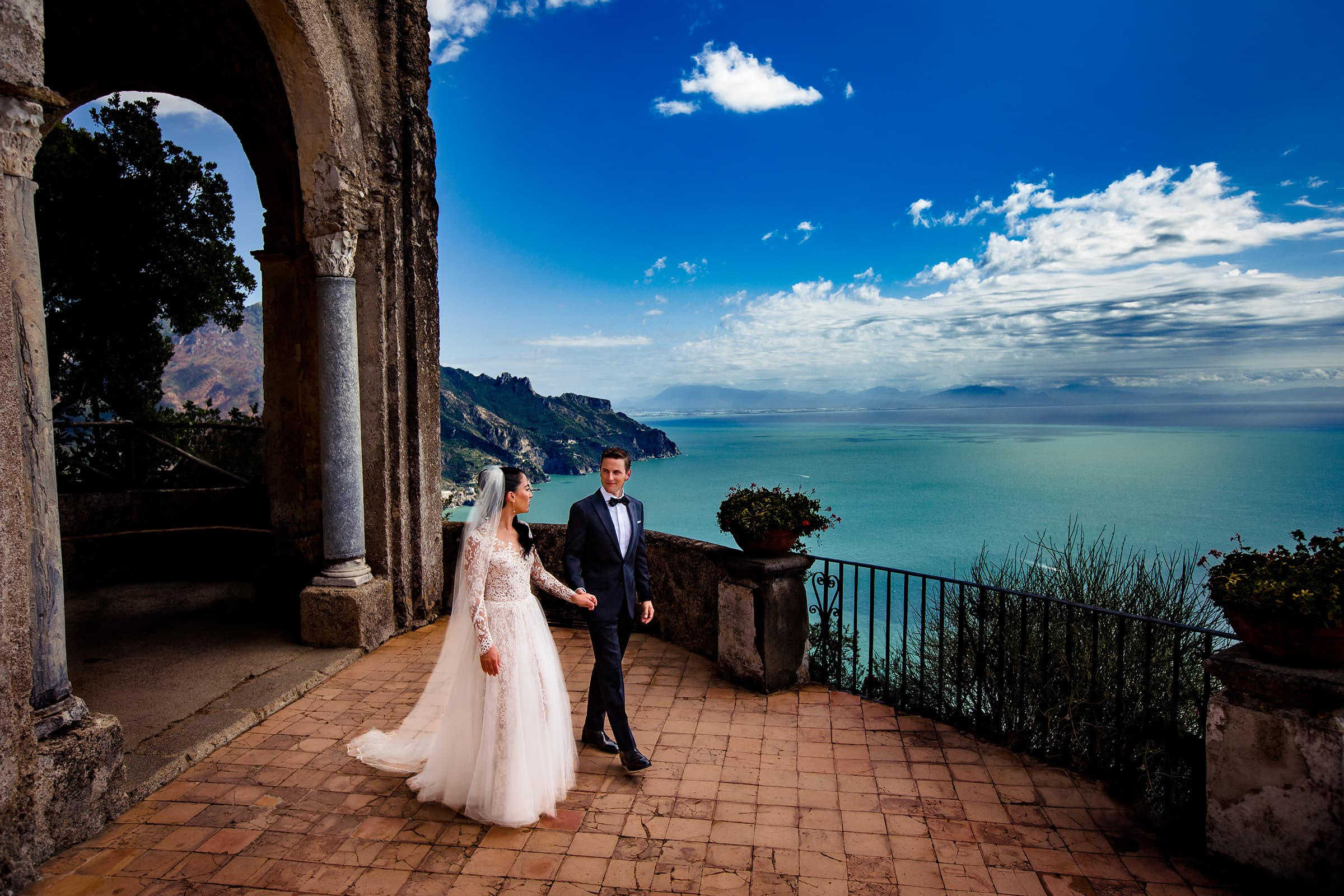 bride and groom walking on the terrace at Villa Cimbrone moments after their Ravello elopement on the Amalfi Coast in Italy