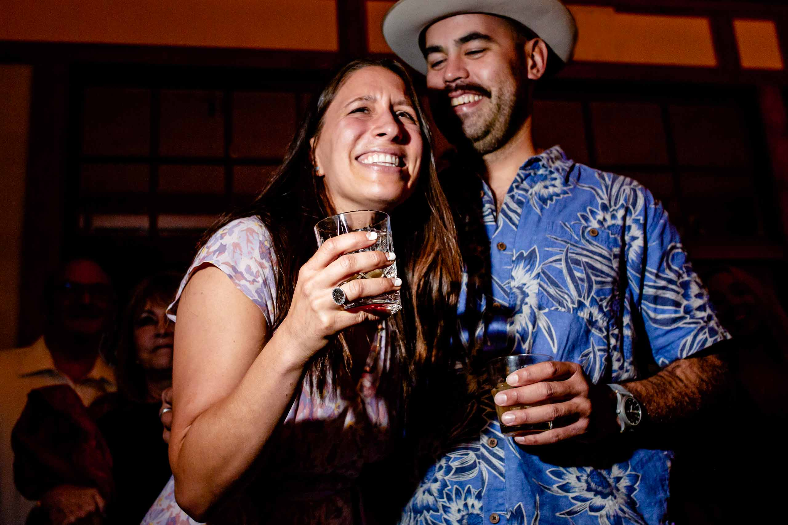 Bride and groom laughing from a friends speech in Hood River the night before their Mt Hood Organic Farms wedding