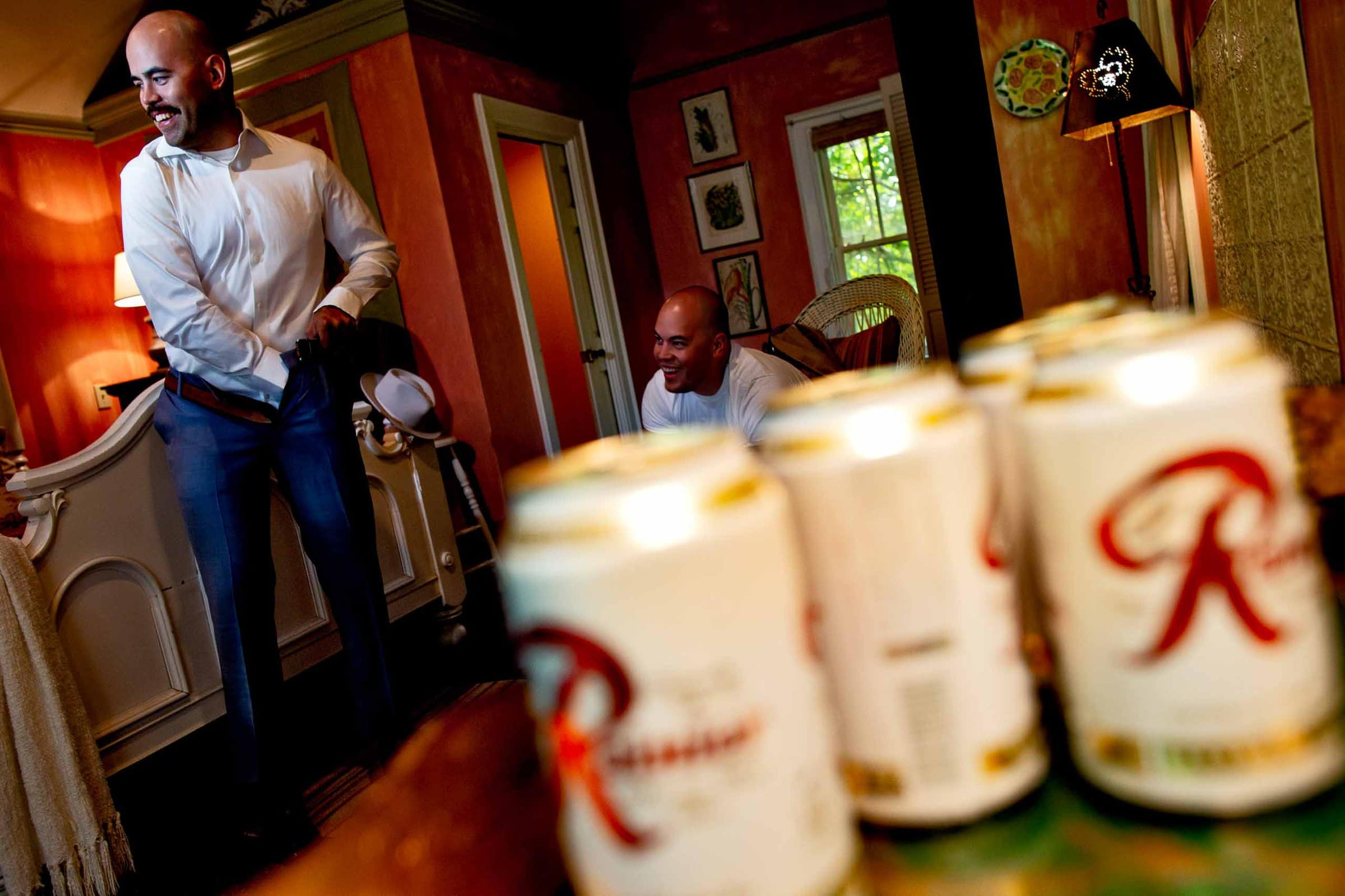 Groom getting ready with beer in the cottage house for his Mt Hood Organic Farms wedding