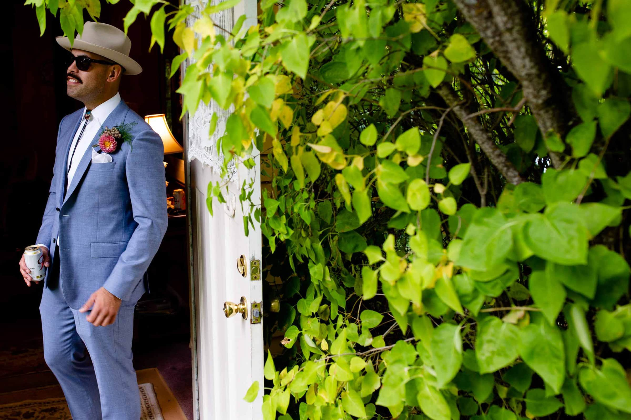Groom dressed in a savvy blue suit while getting ready for his Mt Hood Organic Farms wedding