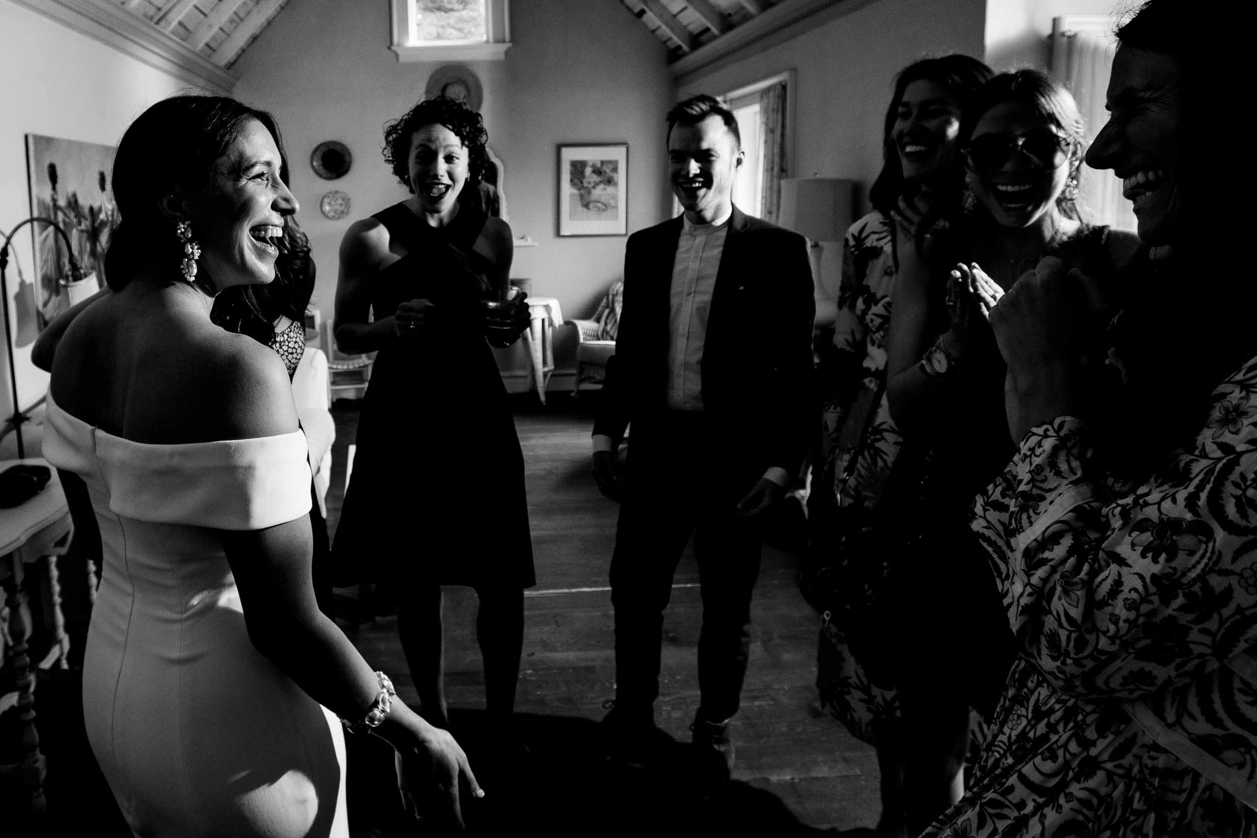 Bride and friends laughing together while getting ready for a Mt Hood Organic Farms wedding ceremony