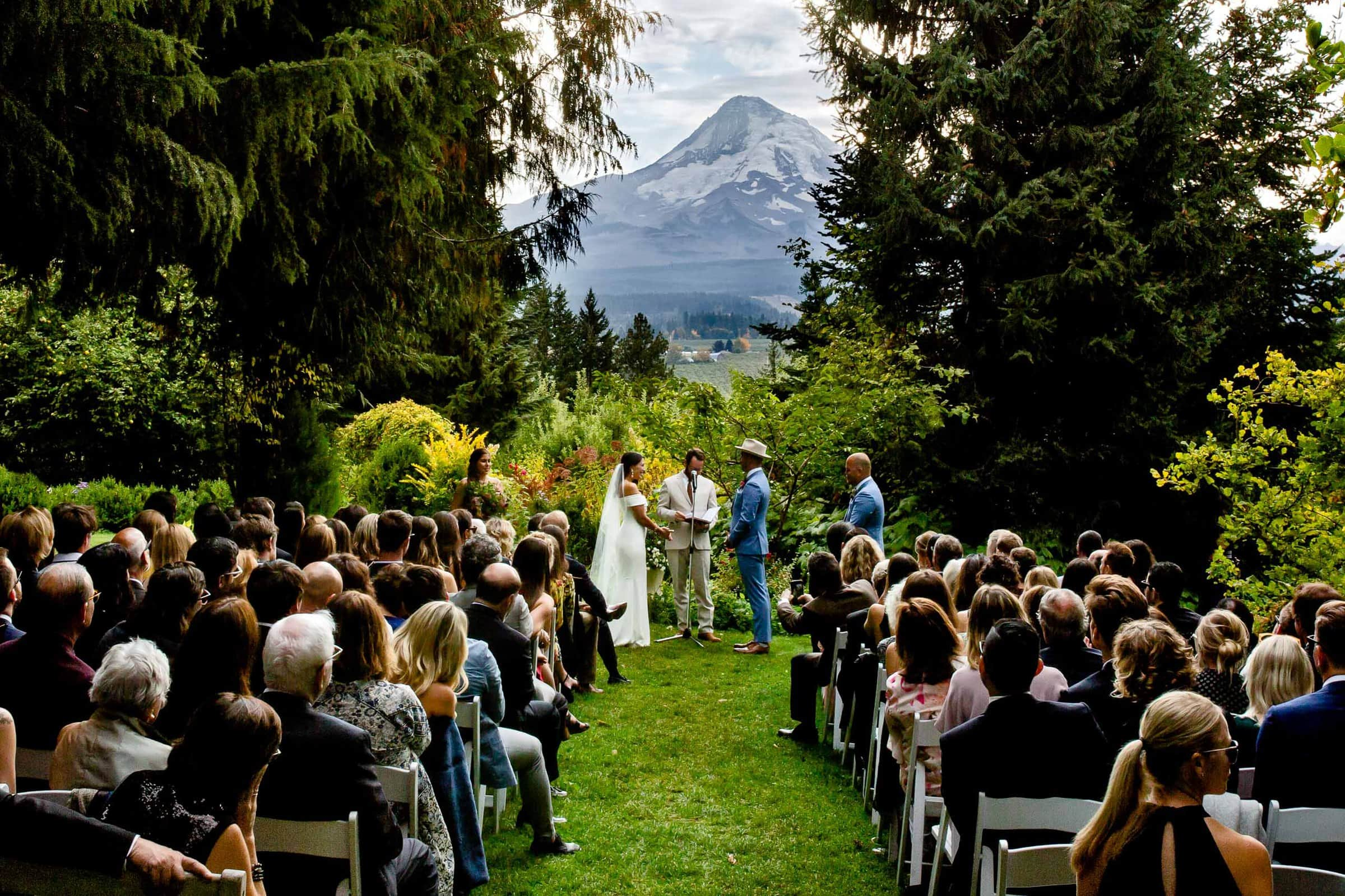 Bride and groom saying vows during a Mt Hood Organic Farms wedding ceremony