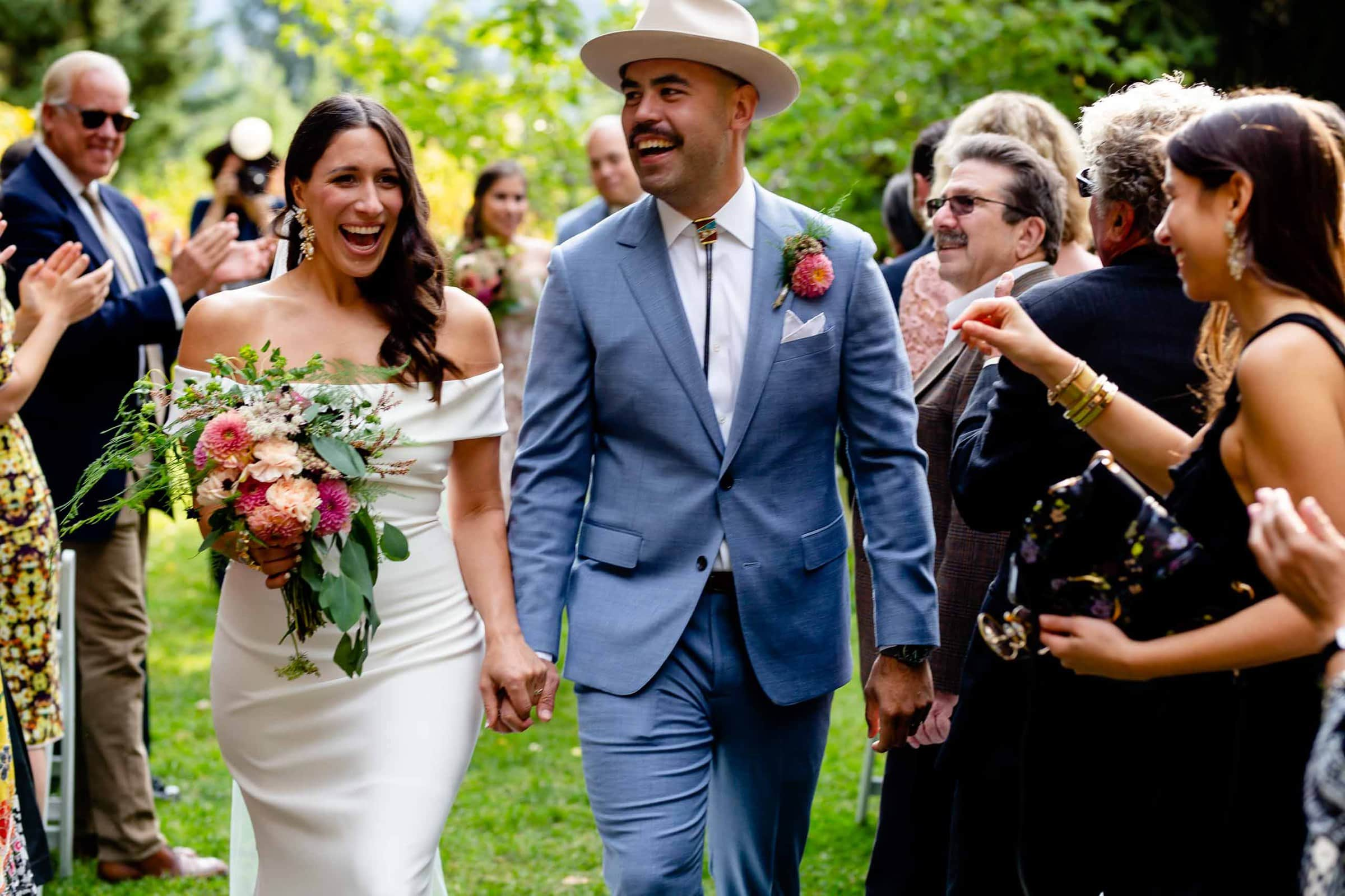 Bride and groom joyously exiting their Mt Hood Organic Farms Wedding ceremony