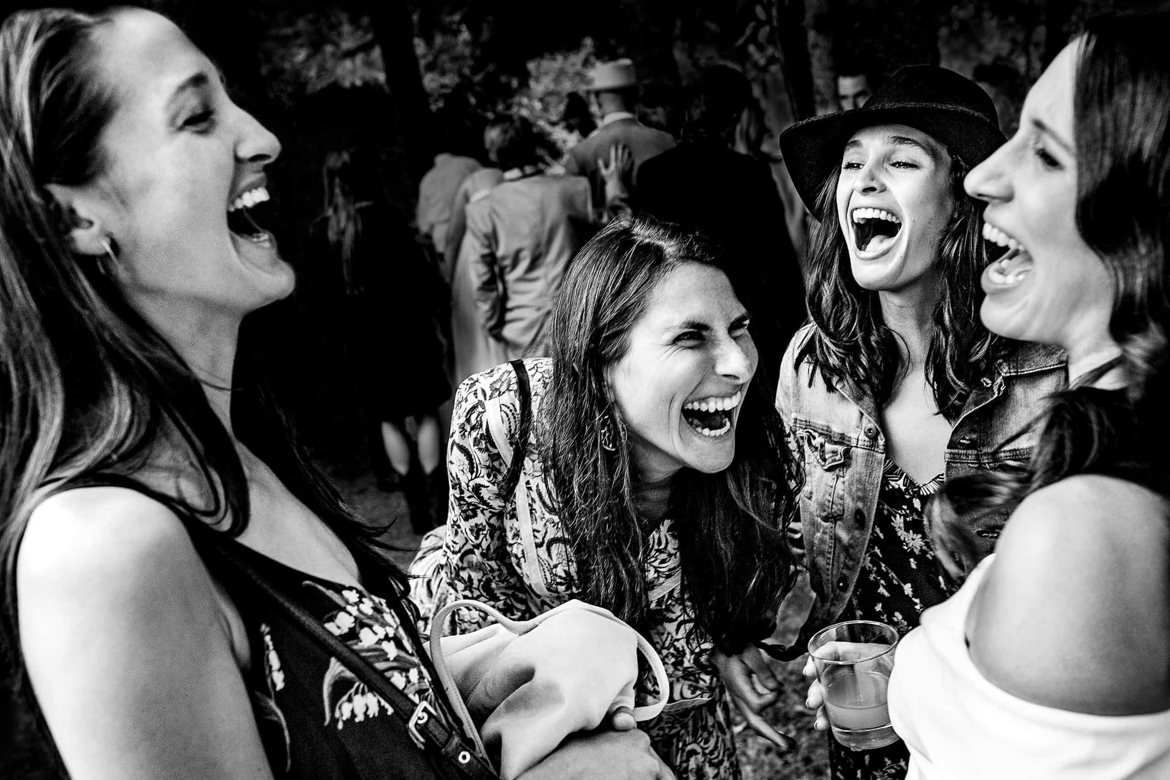 Brides best friends laughing together in a beautiful composition at a Mt Hood Organic Farms wedding