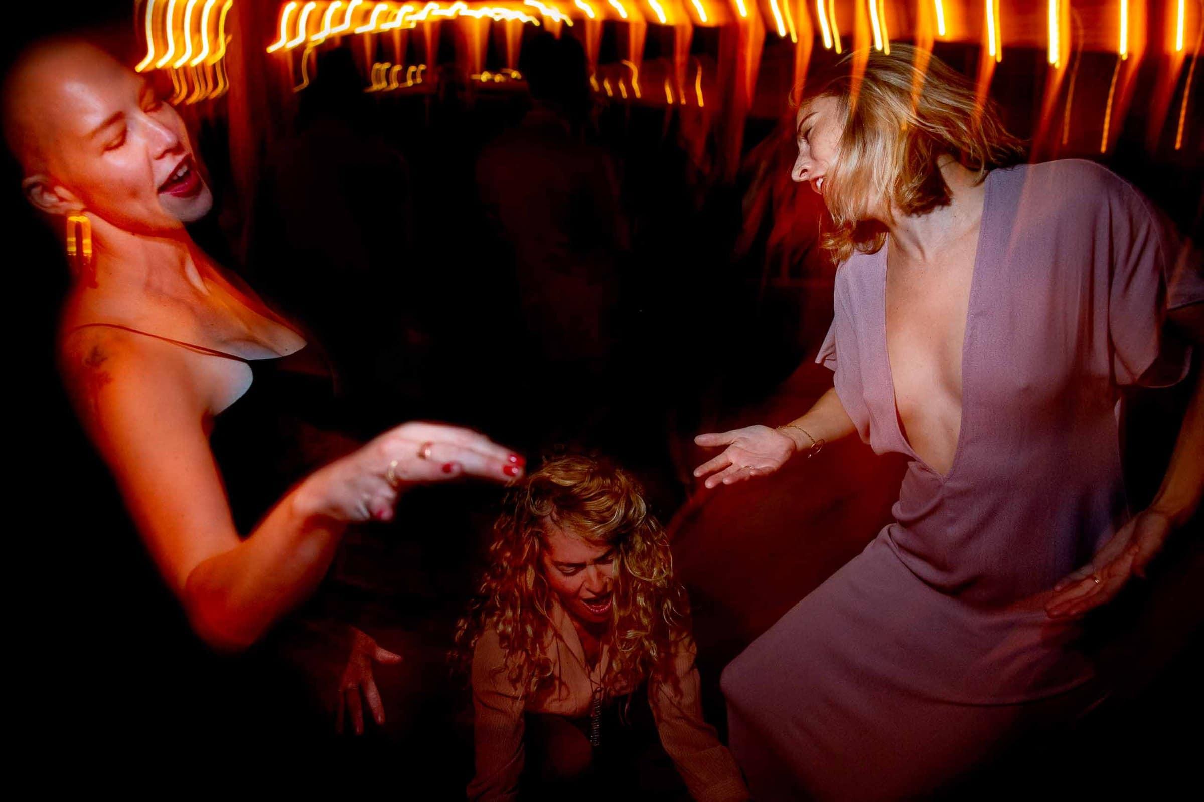 Fun friends dancing at a Mt Hood Organic Farms wedding reception