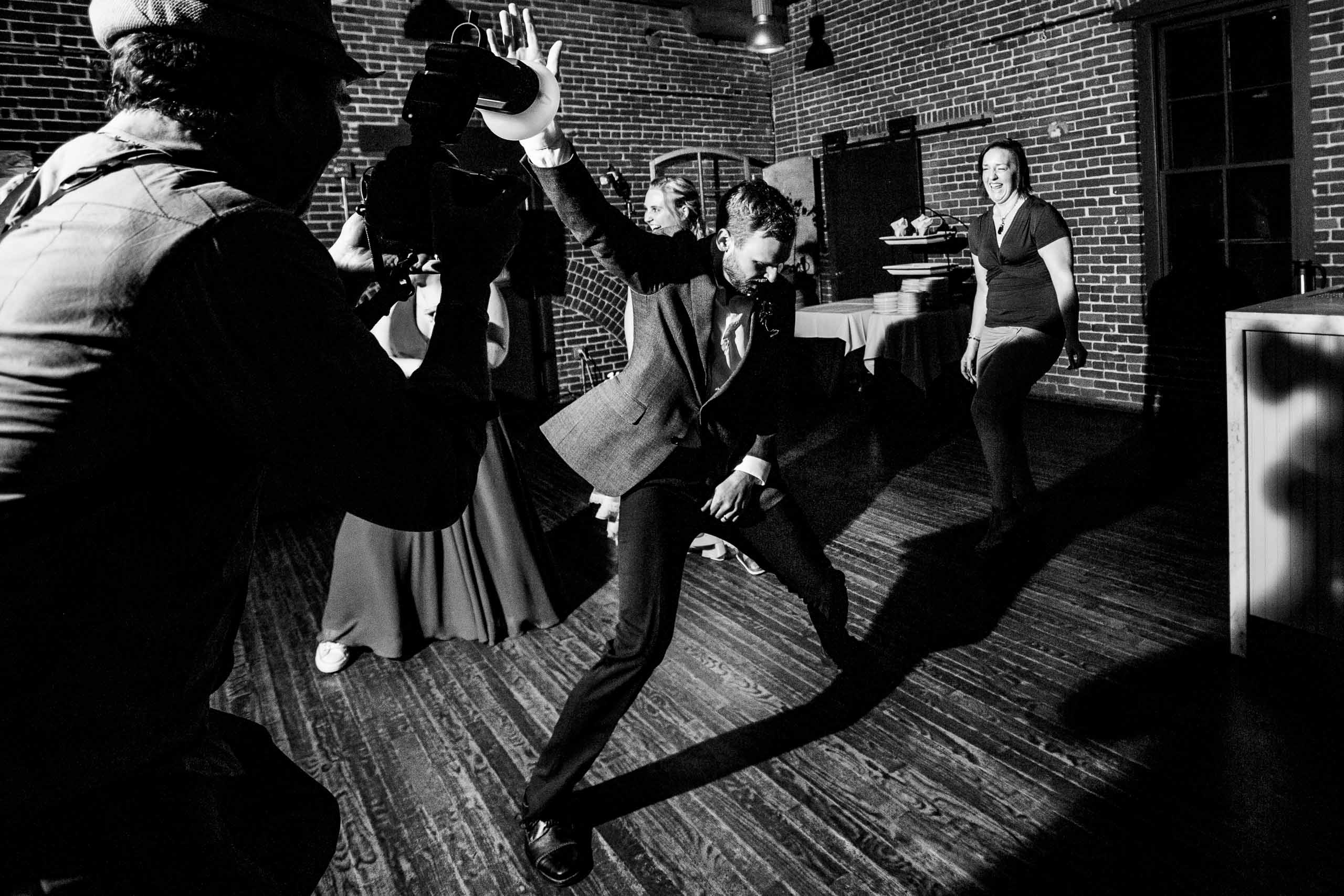 Groom dancing wild at Bridgeport Heritage Room in Portland during their reception after after their Mt Hood Meadows wedding at Umbrella Falls