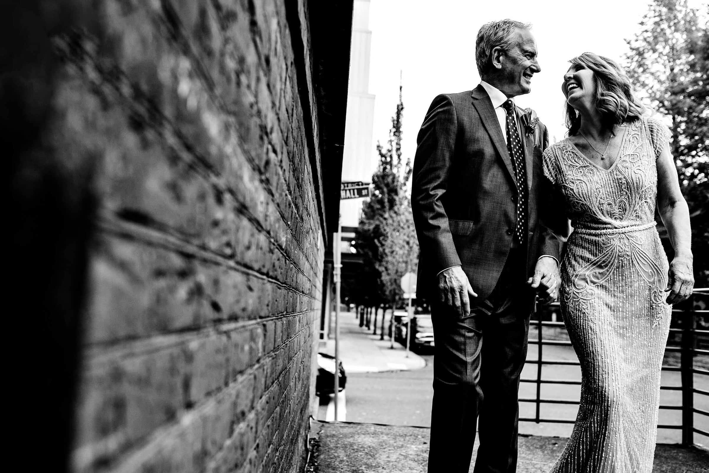 Bride and Groom walking into Ceruleun Wine Cellar Bar before their wedding in Portland Pearl District