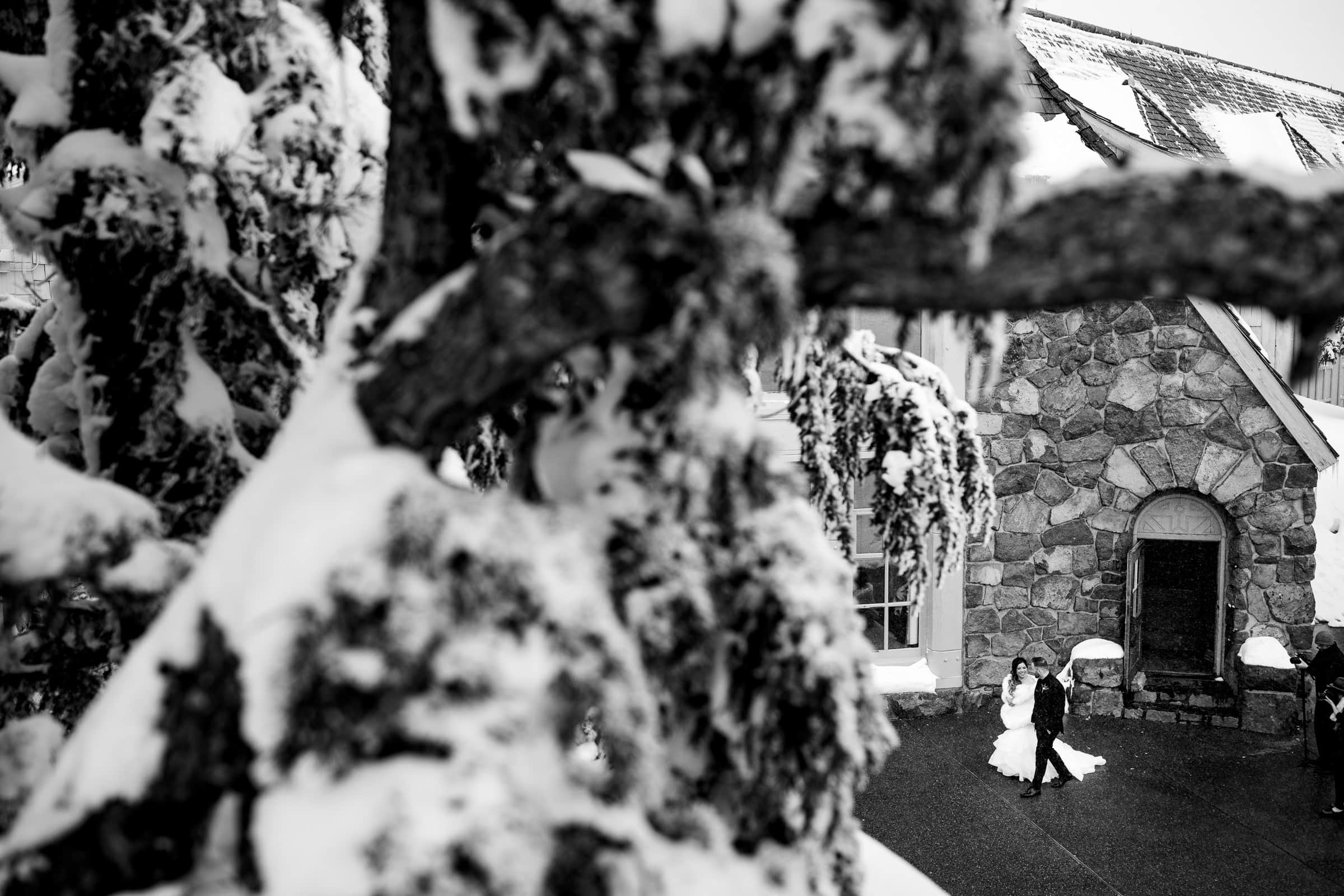Bride and groom walking together in snow outside moments before their Timberline Lodge Wedding ceremony.