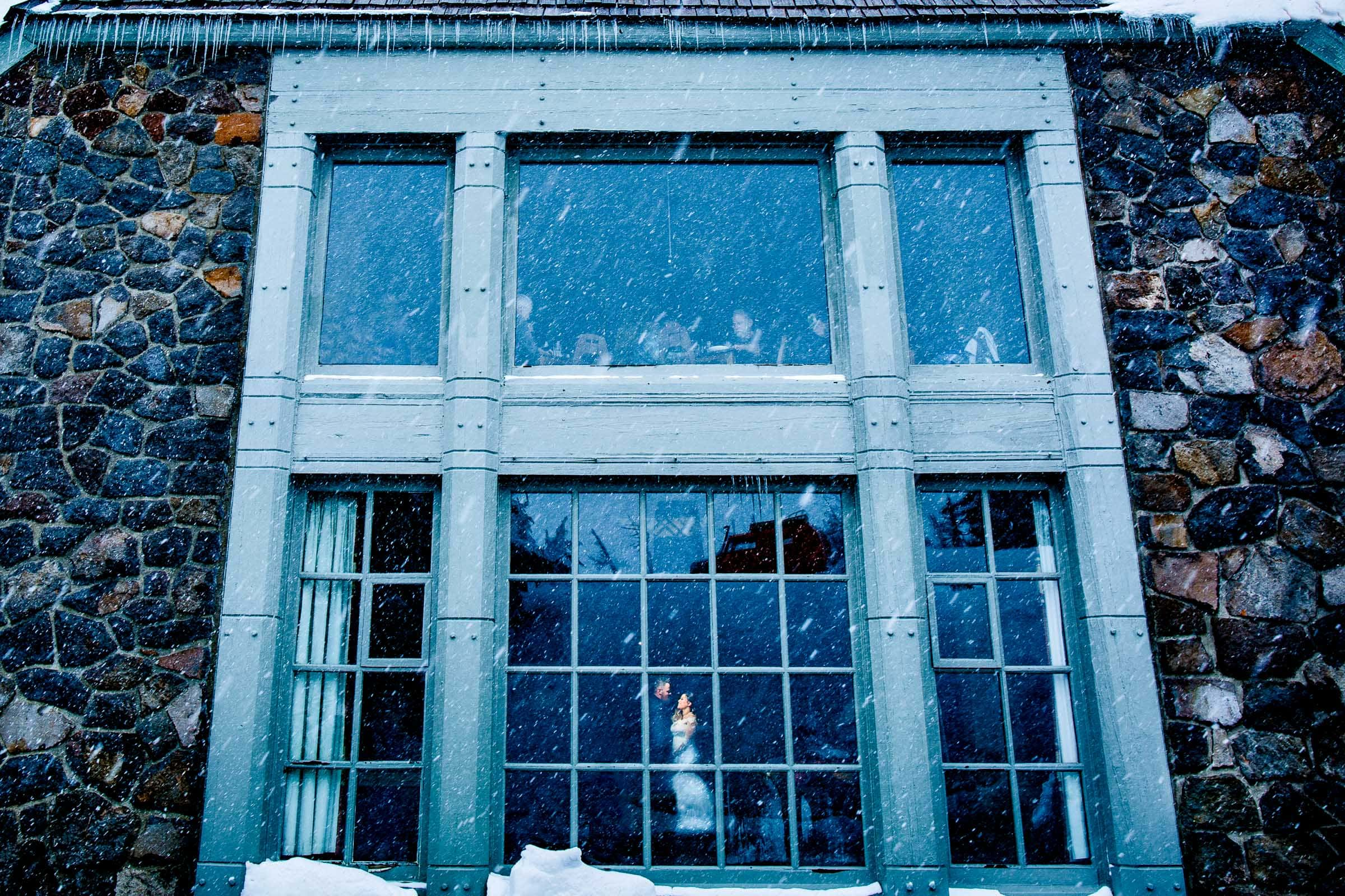 Bride and groom photo inside the lodge with of snow moments before their Timberline Lodge Wedding ceremony.