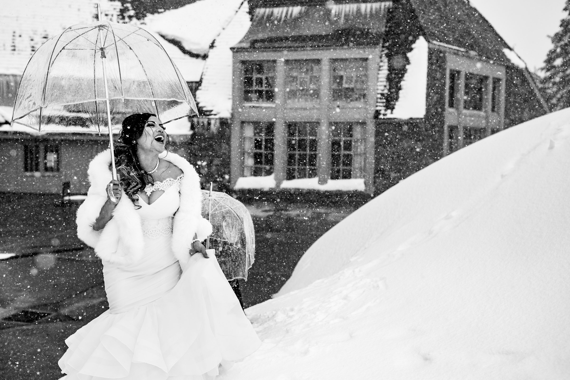 Bride laughing while walking outside in the snow before her Timberline Lodge Wedding ceremony