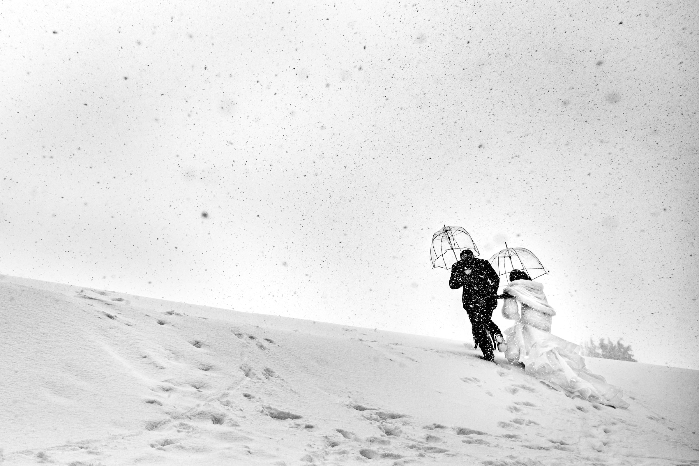 Bride and groom while walking outside in the snow before their Timberline Lodge Wedding ceremony